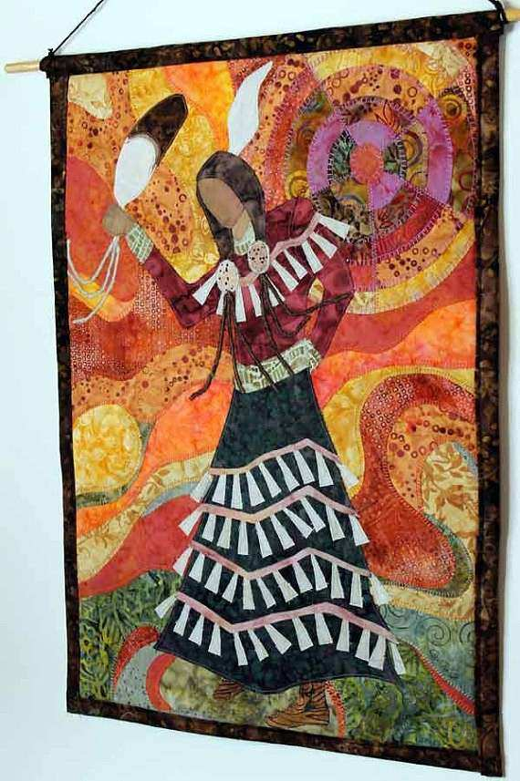 Quilted wall hanging of Native American Jingle Dress Dancer