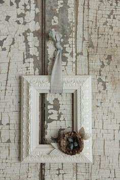 Take an old frame and tie ribbon around it to hang