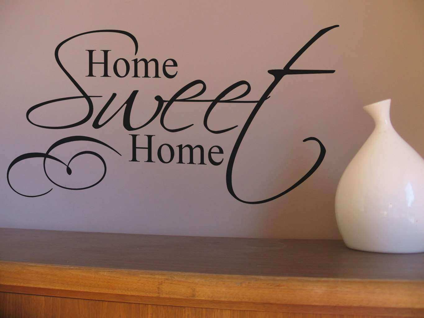 Create a homely space with this Home Sweet Home wall art decal
