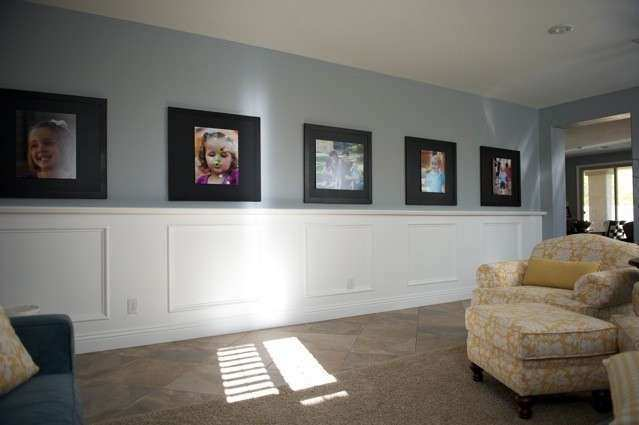 Decorating with Portraits Long entryway filled with
