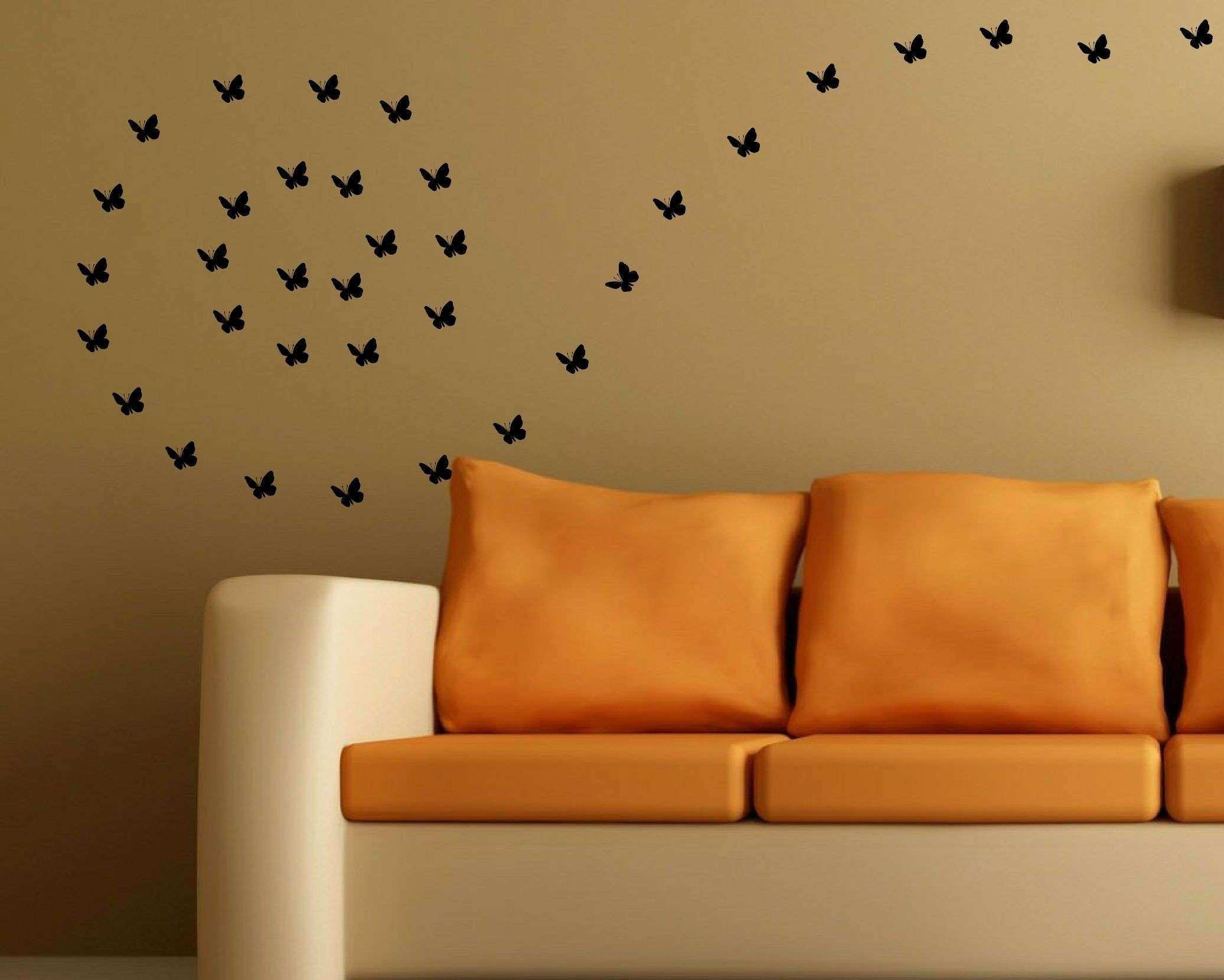 Black butterfly wall decal on a sand color brown wall