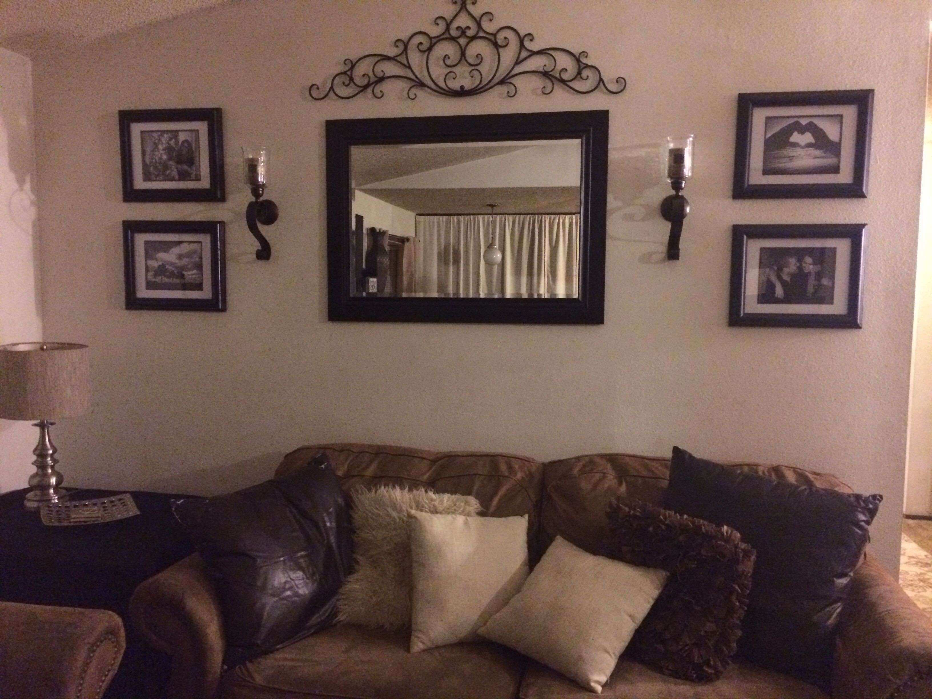 behind couch wall in living room mirror frame sconces