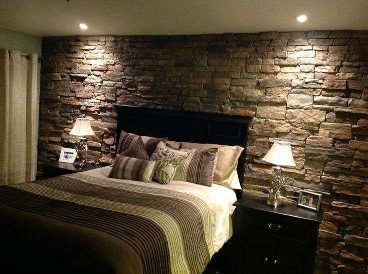 Rock accent wall in the master bedroom