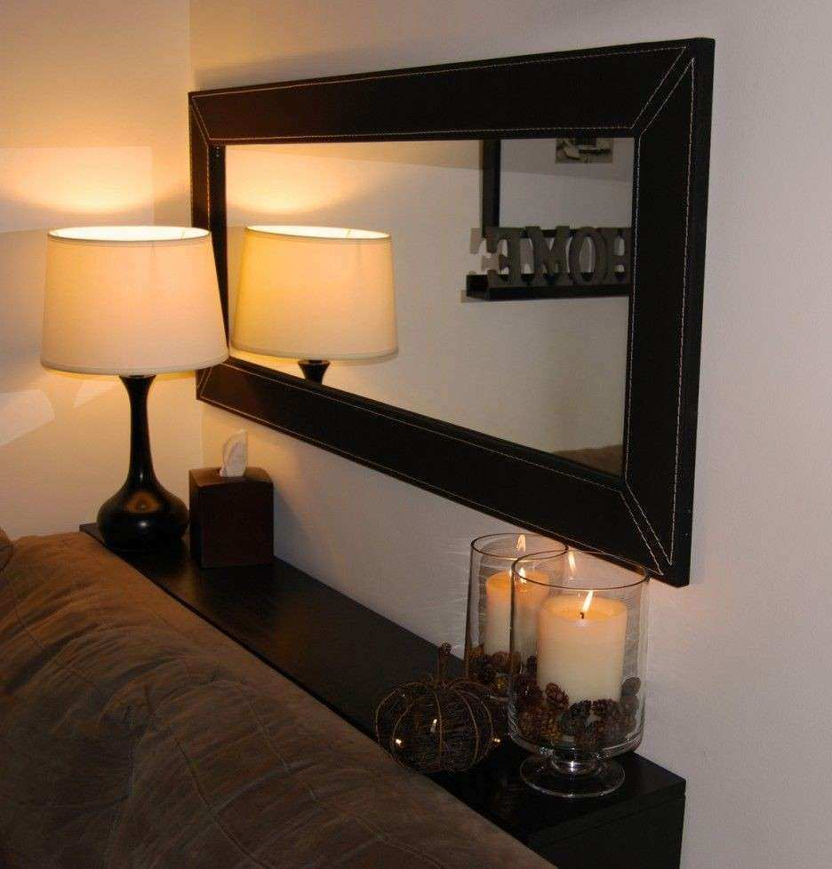 Horizontal mirror above couch with DIY shelf behind sofa