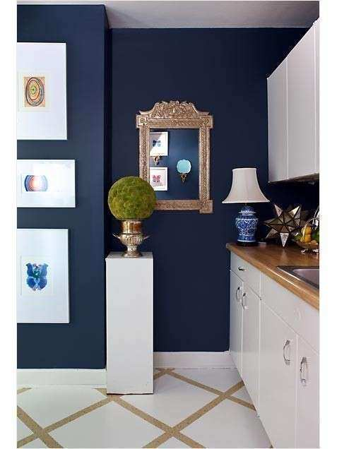 Navy wall gold frame and topiary