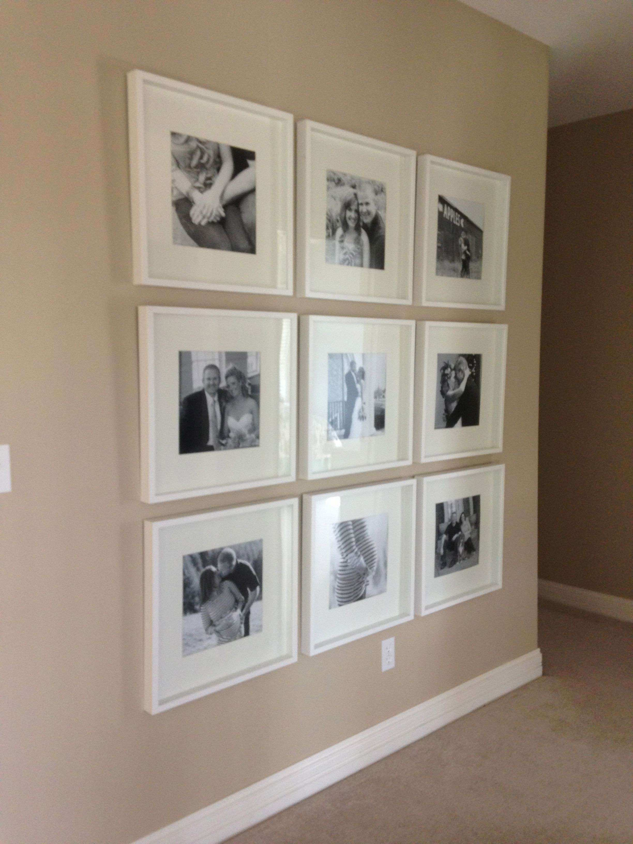 Black and white photo wall with Ikea frames chronological order