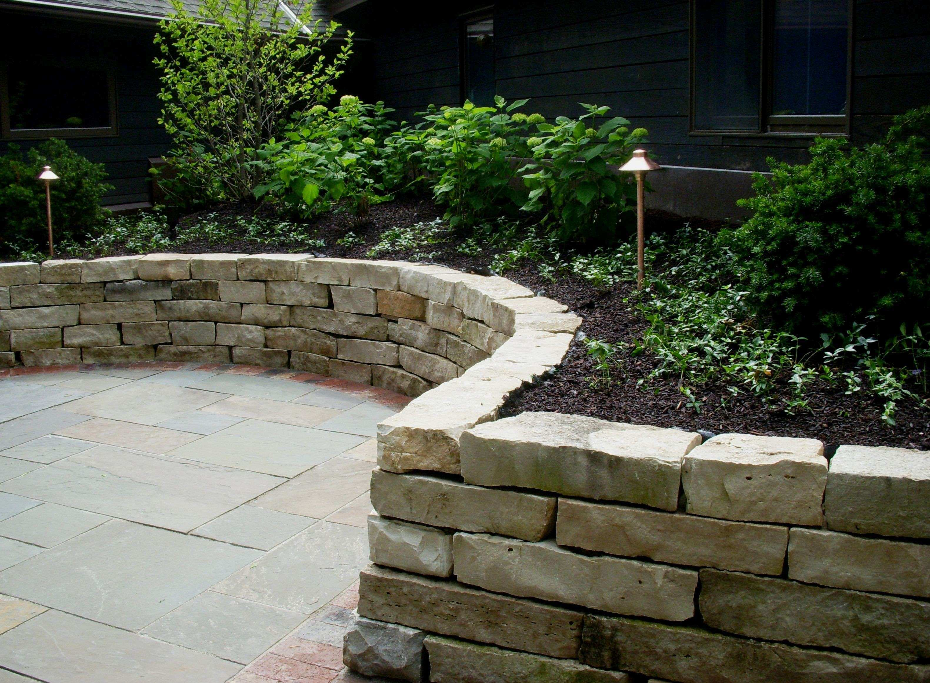 Lannon stone retaining wall dry laid The Garden