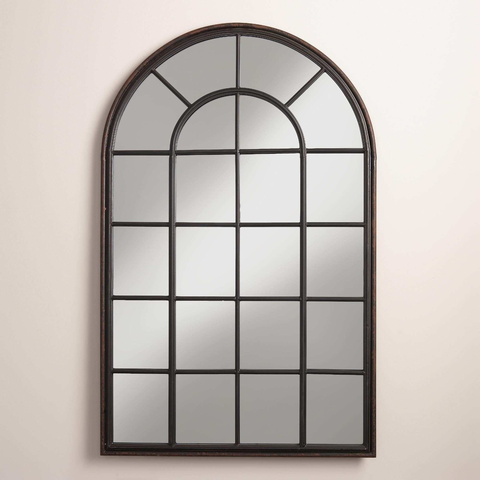 Our window inspired iron mirror features a broad arch and an aged