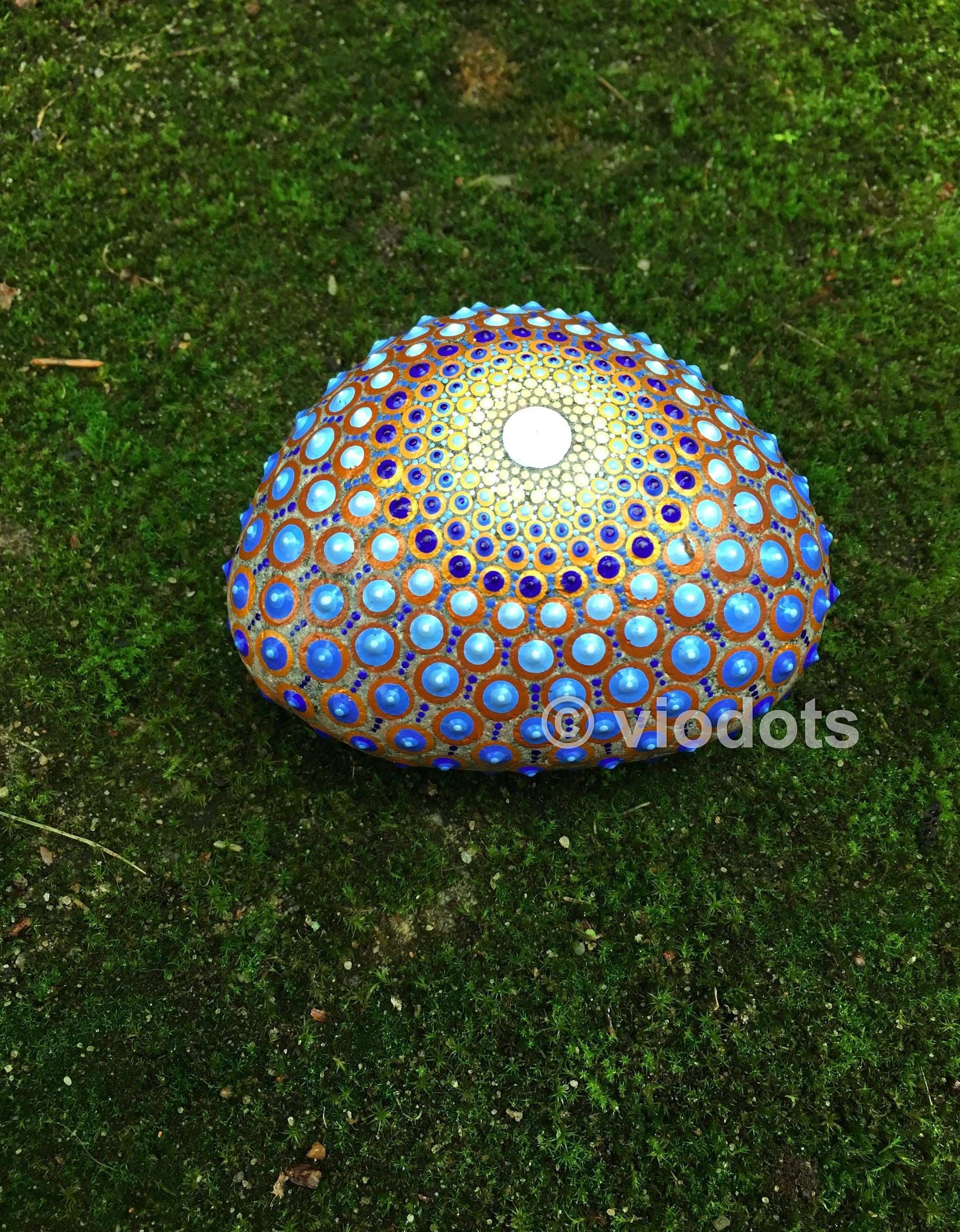 The stone has been created with acrylic paint and protected with