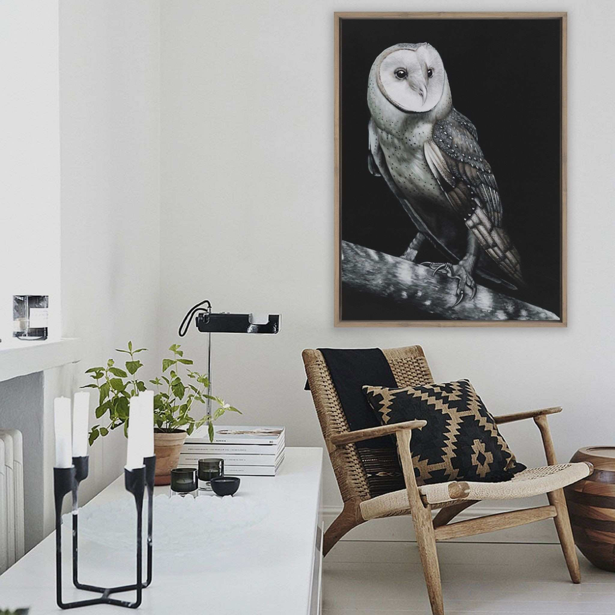 Featuring a striking owl perched on a branch and set against a