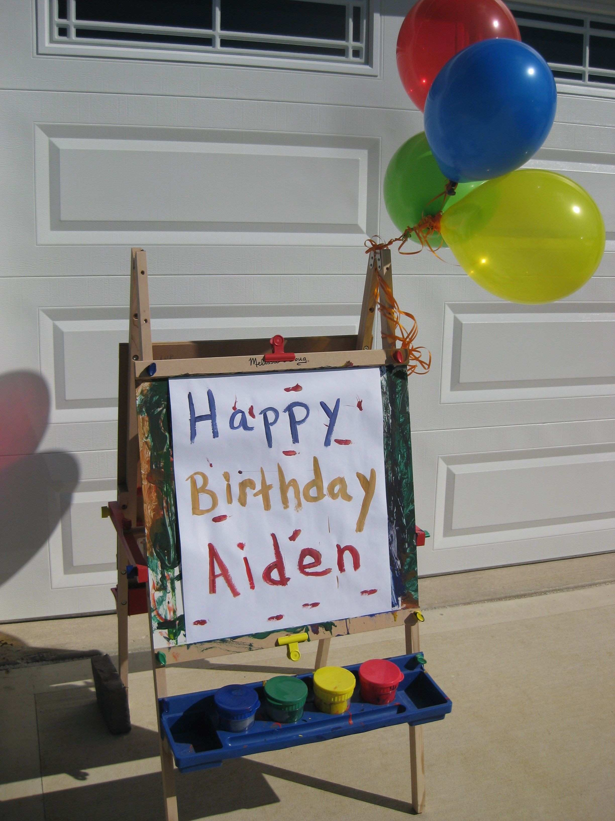 Outdoor decor Art easel with birthday message and balloons
