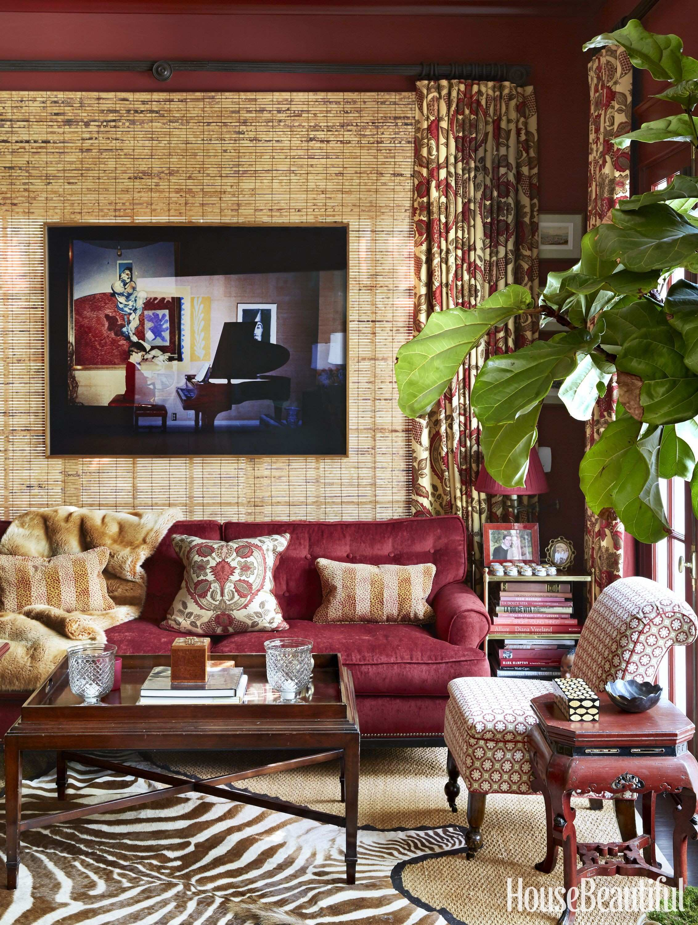 """Burgundy Walls """"Nothing transports like a deep red room """" says"""