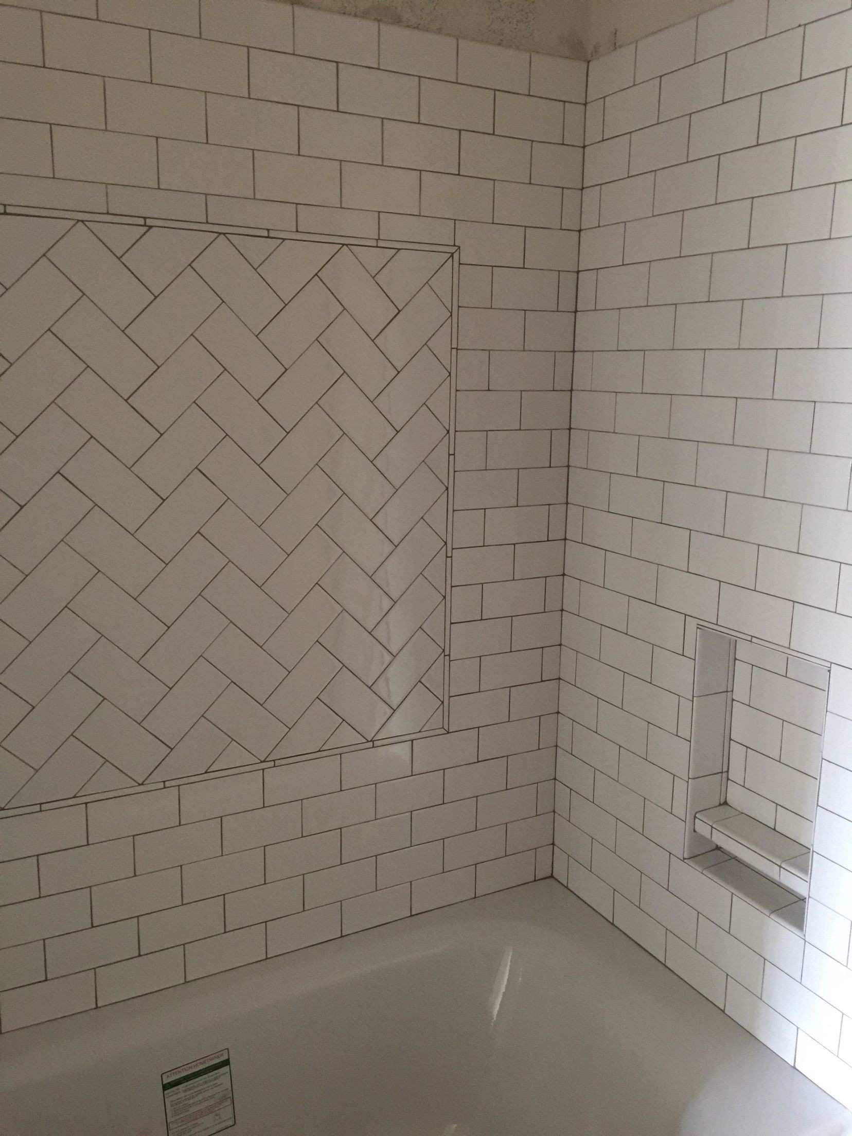 My kids new tub and tile surround White subway tiles with oyster