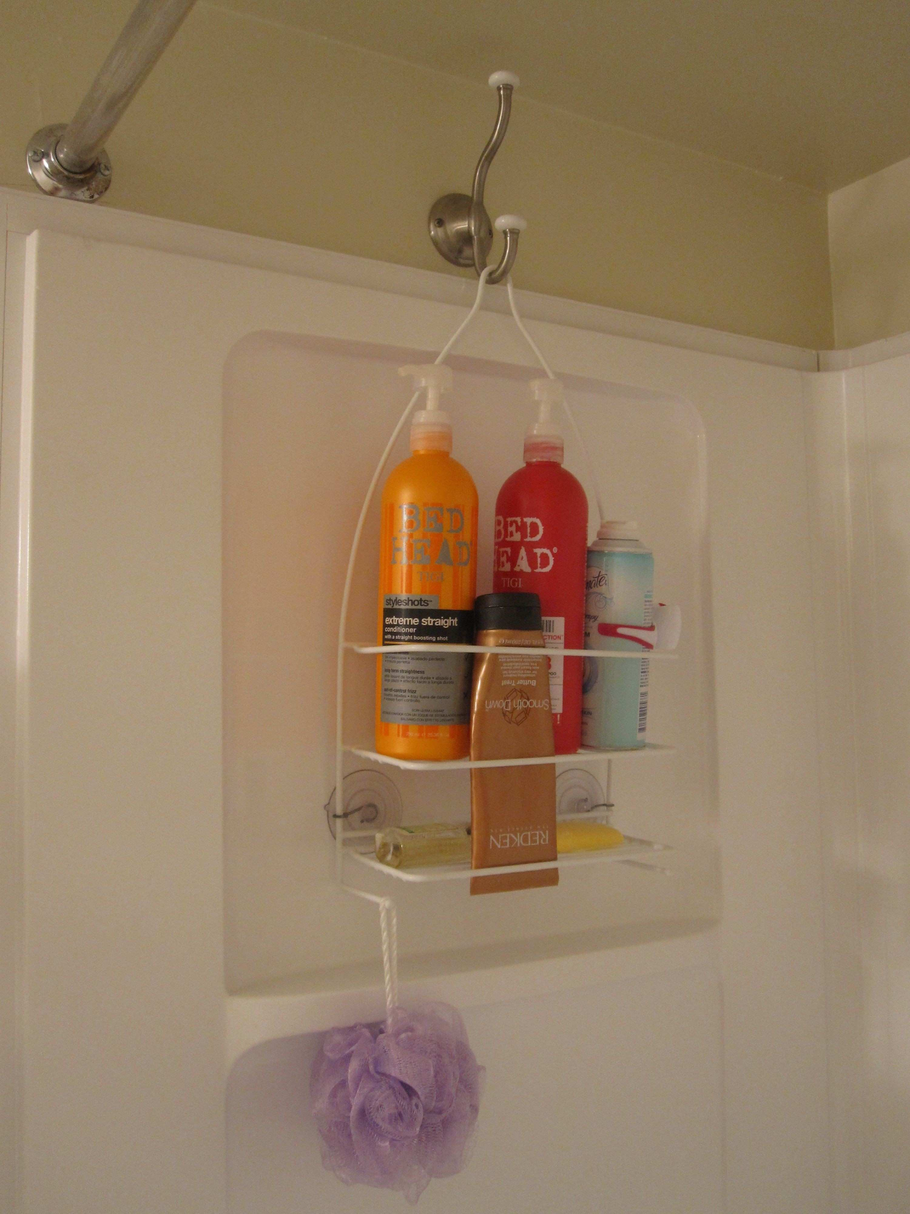 I prefer hanging my shower caddy on the opposite side of the shower