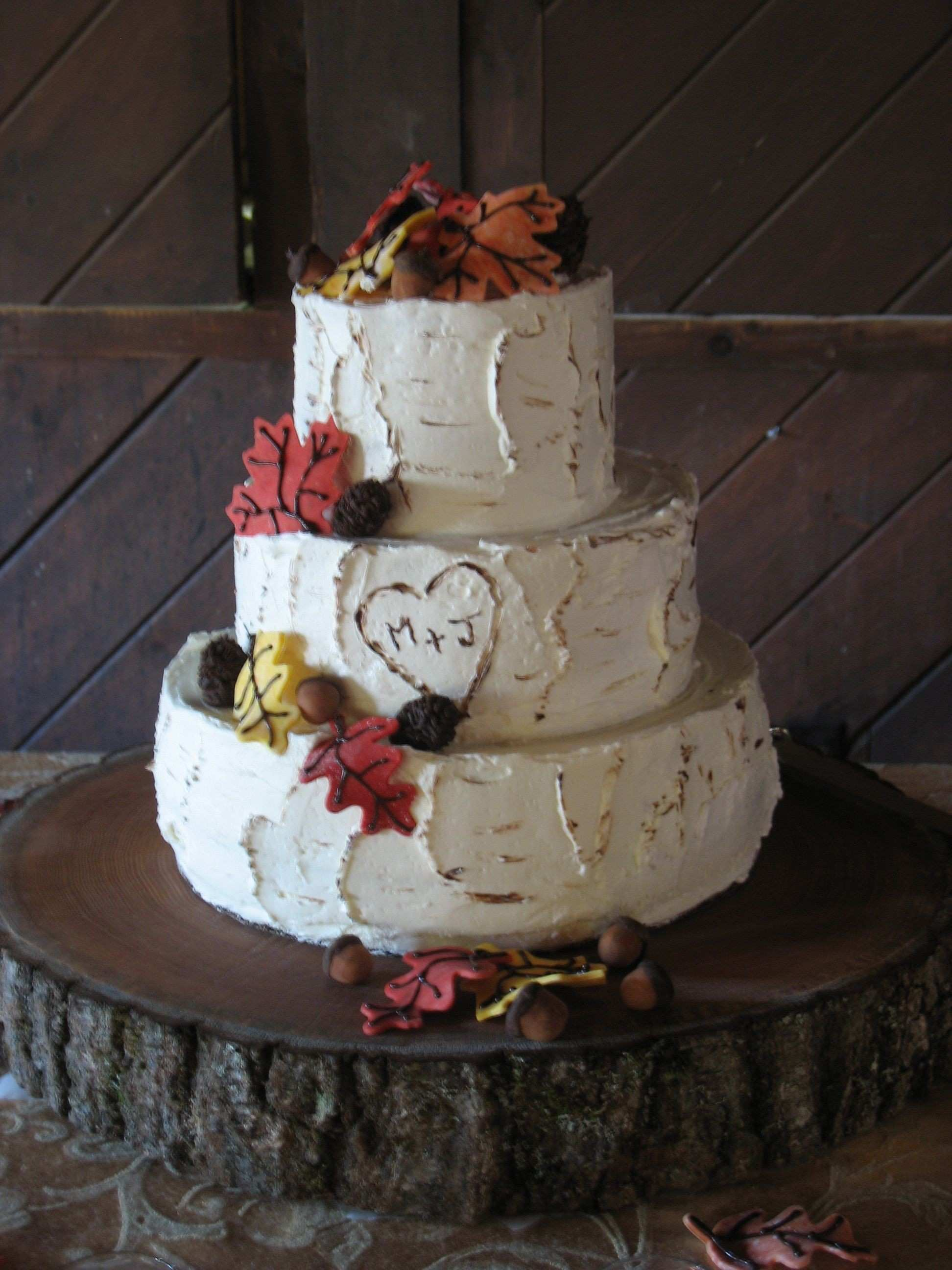 Birch inspired wedding cake with carved heart and initials fondant