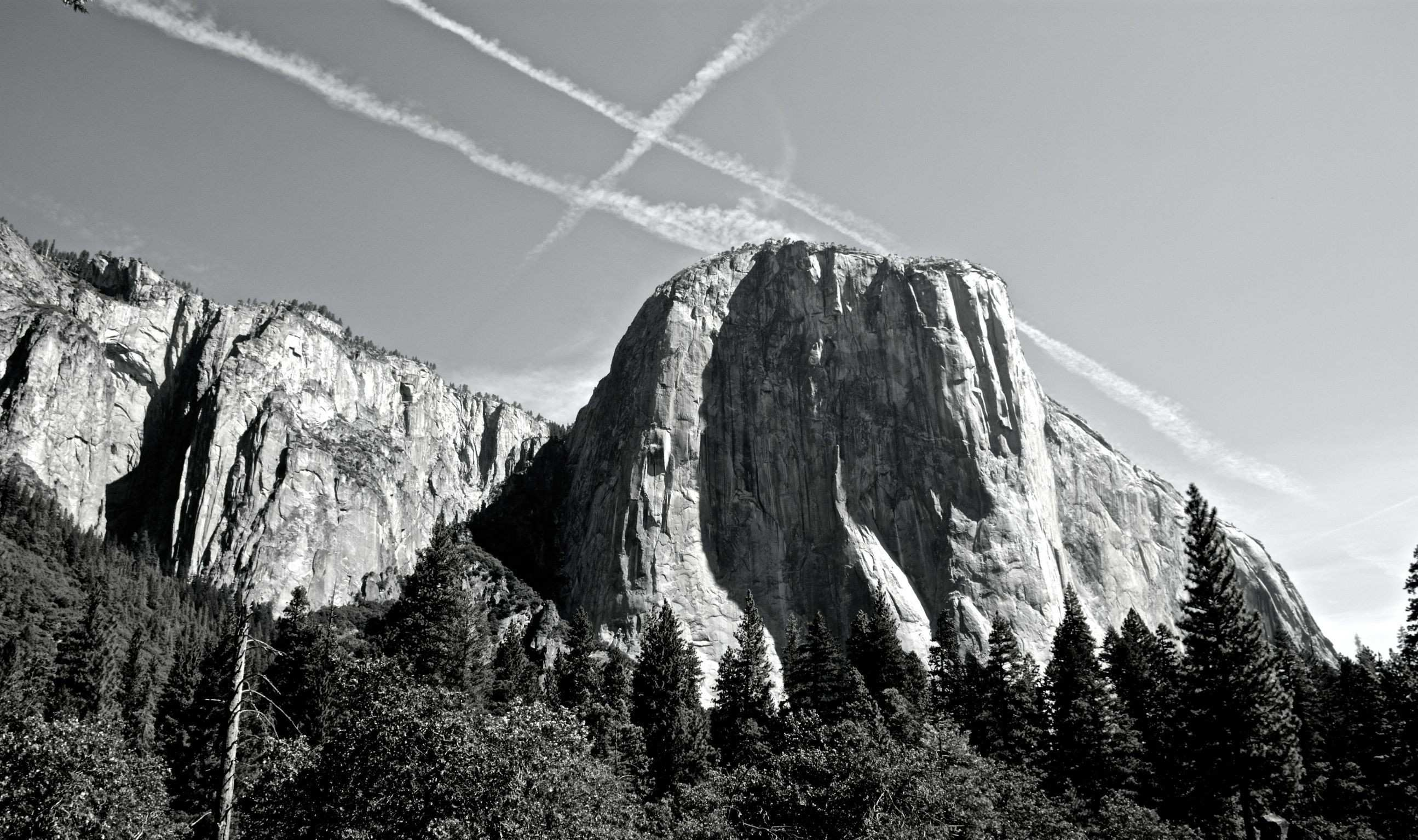 Man made lines of symmetry above nature made cliffs of irregularity