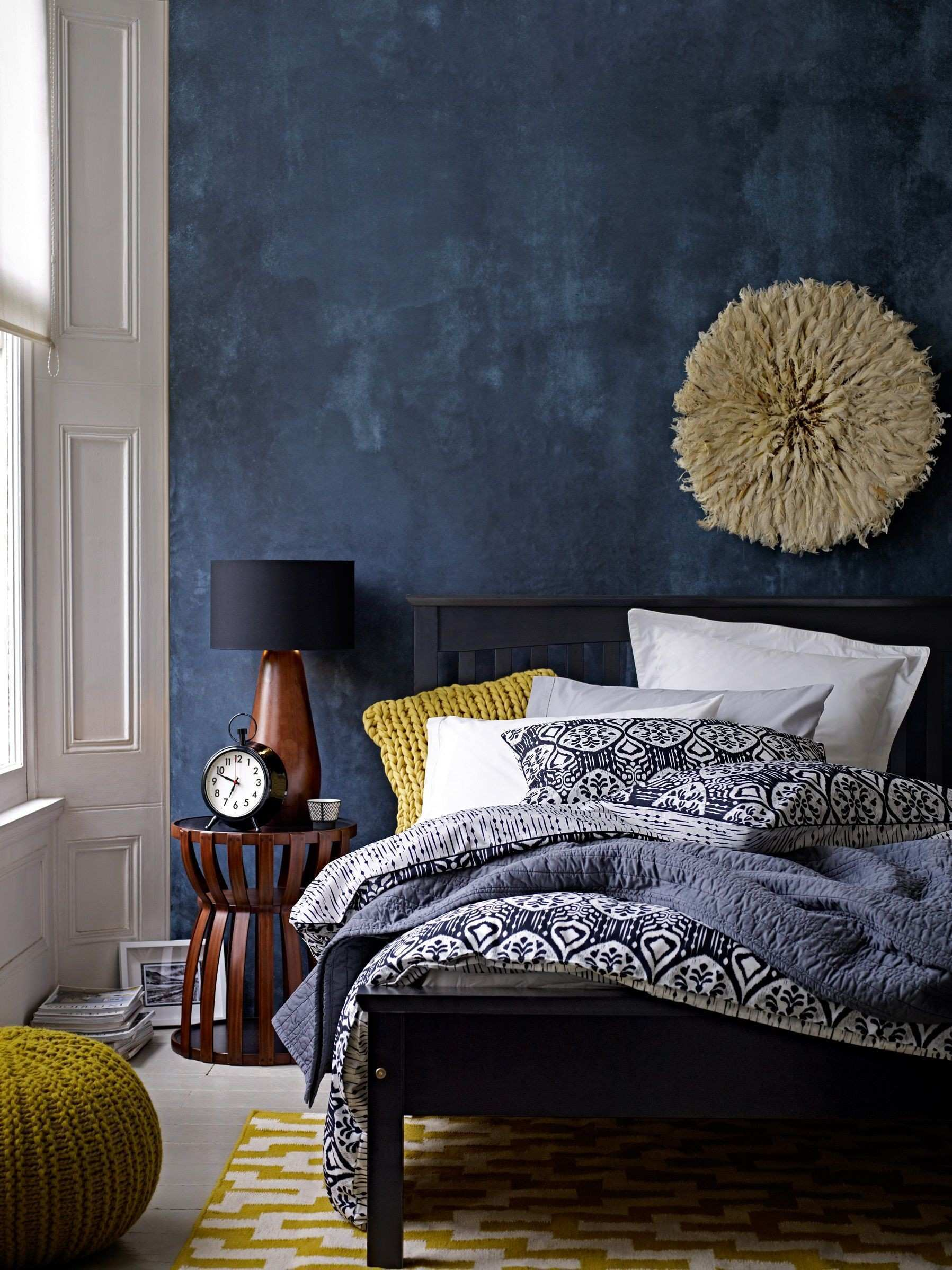 deep blue accent wall in modern eclectic bedroom gorgeous use of