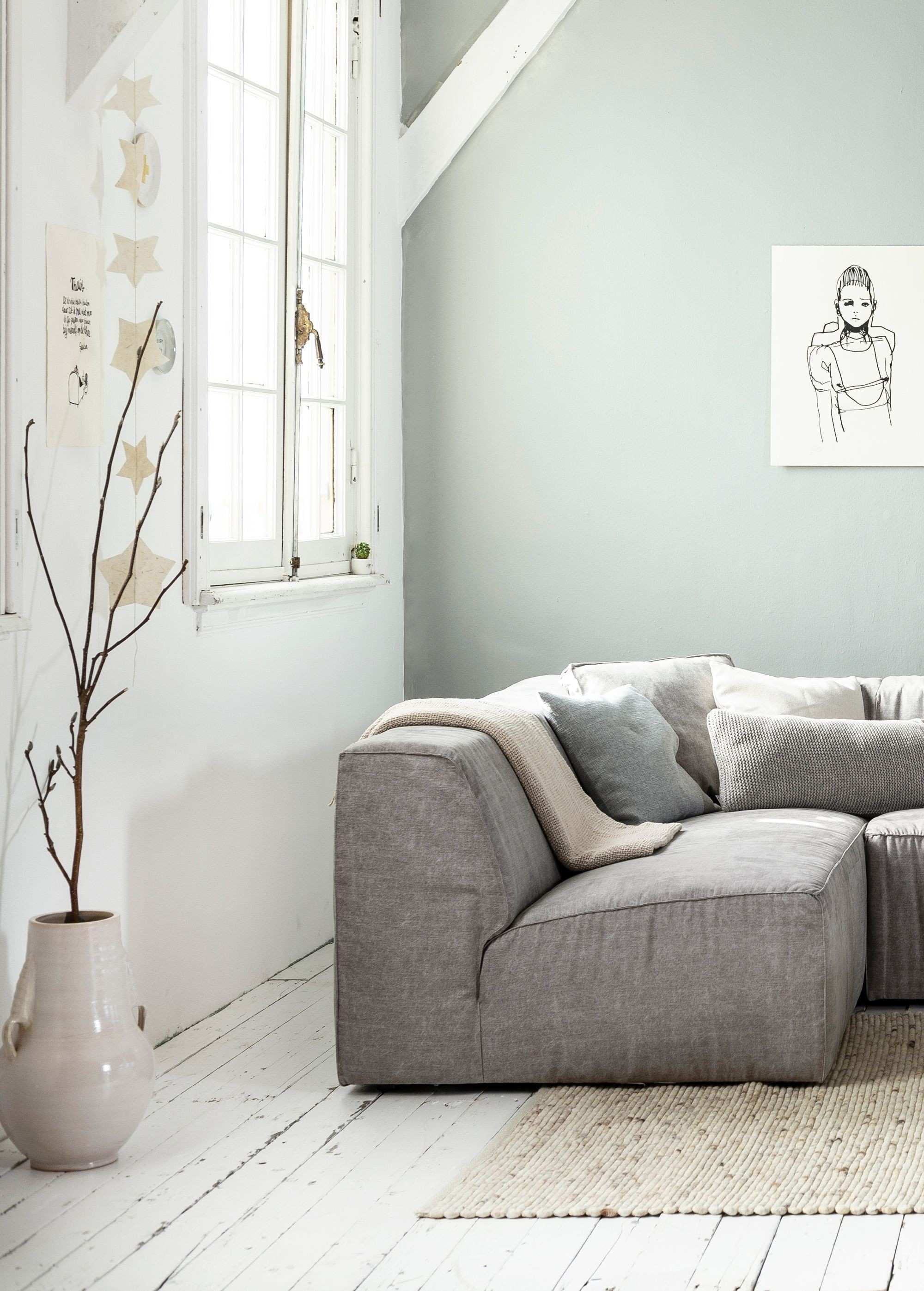 White grey and light interior living room with white wooden