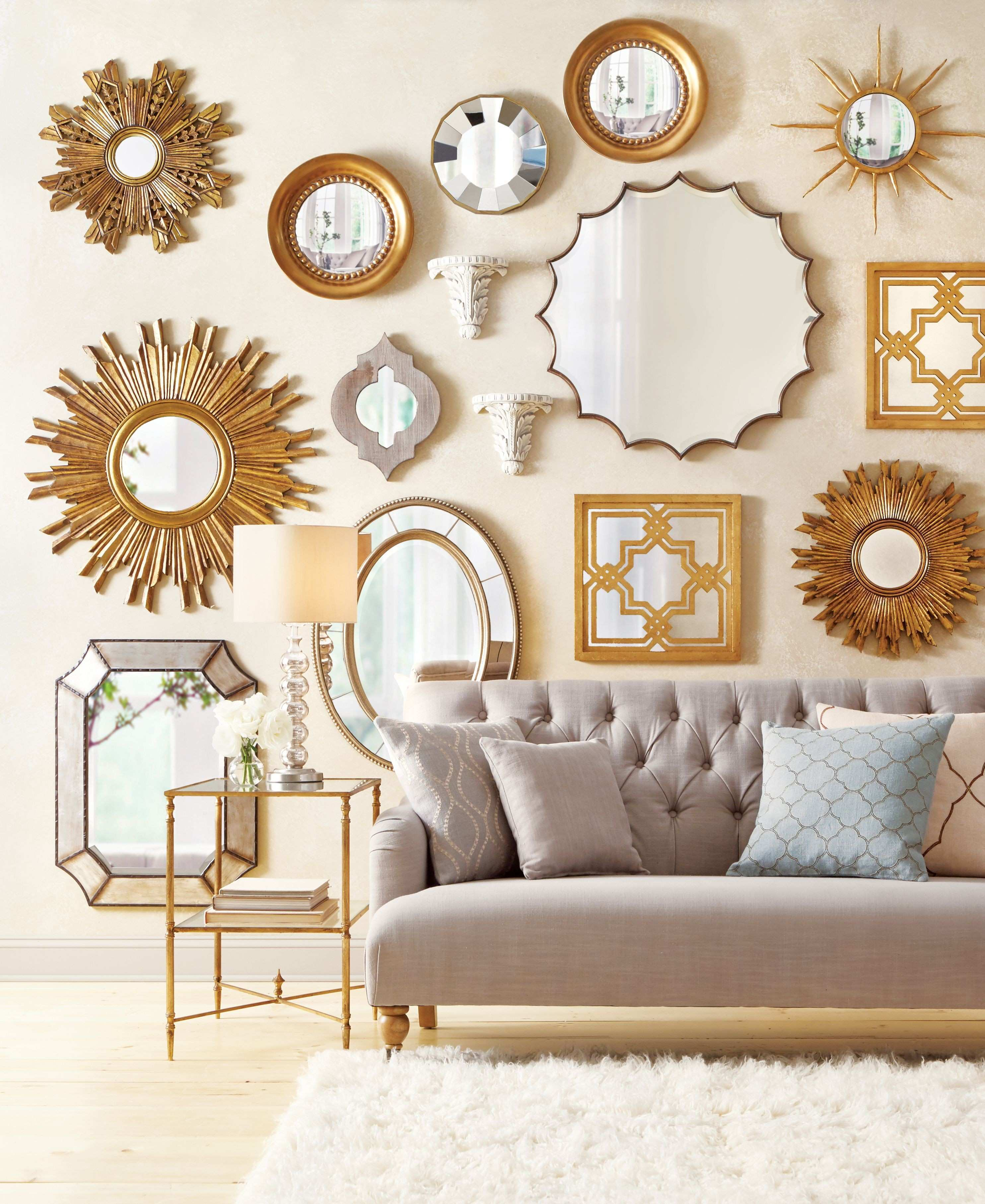 Mirrors make a wall stand out so well Love this gallery wall design