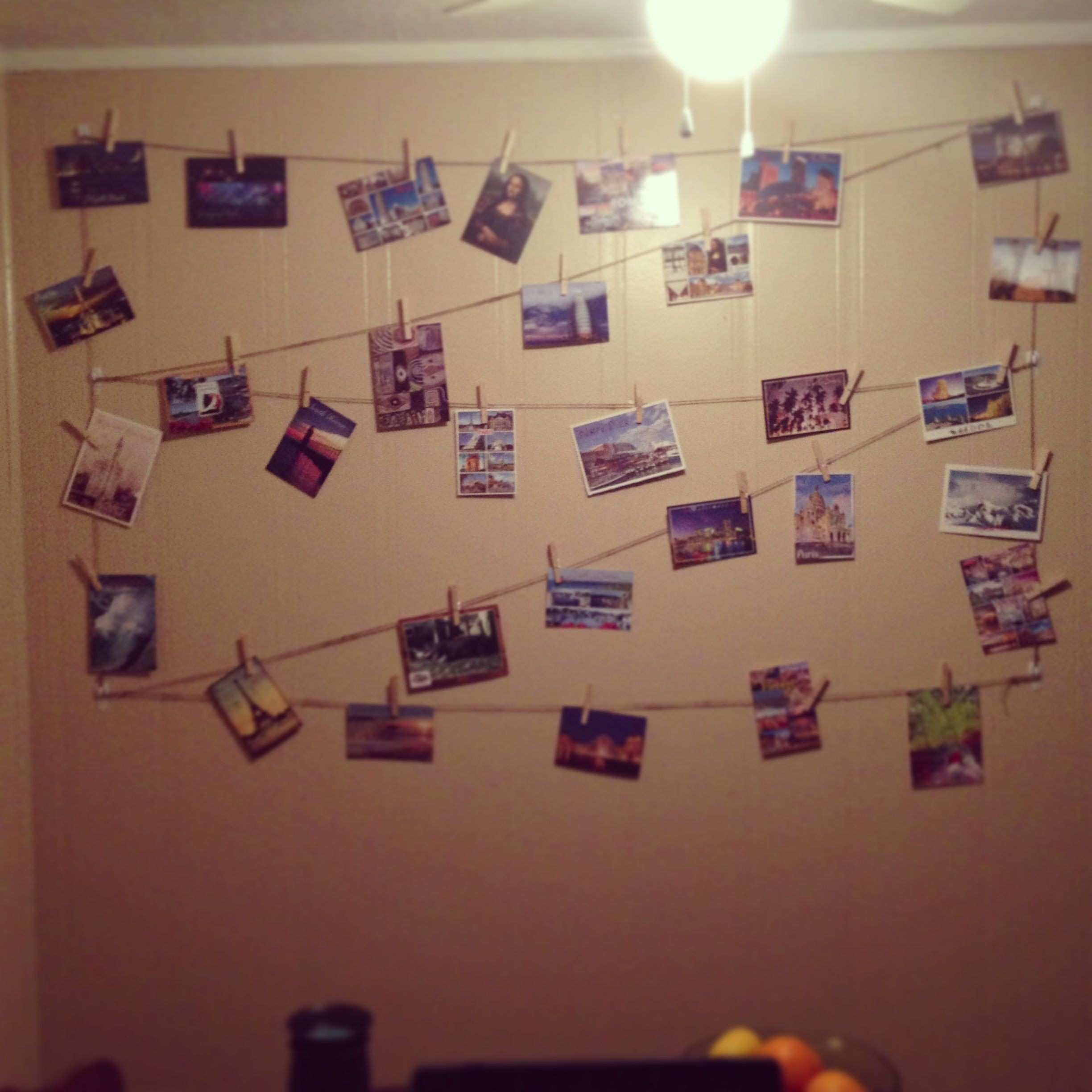 Postcard Display With twine mand hooks and clothes pins