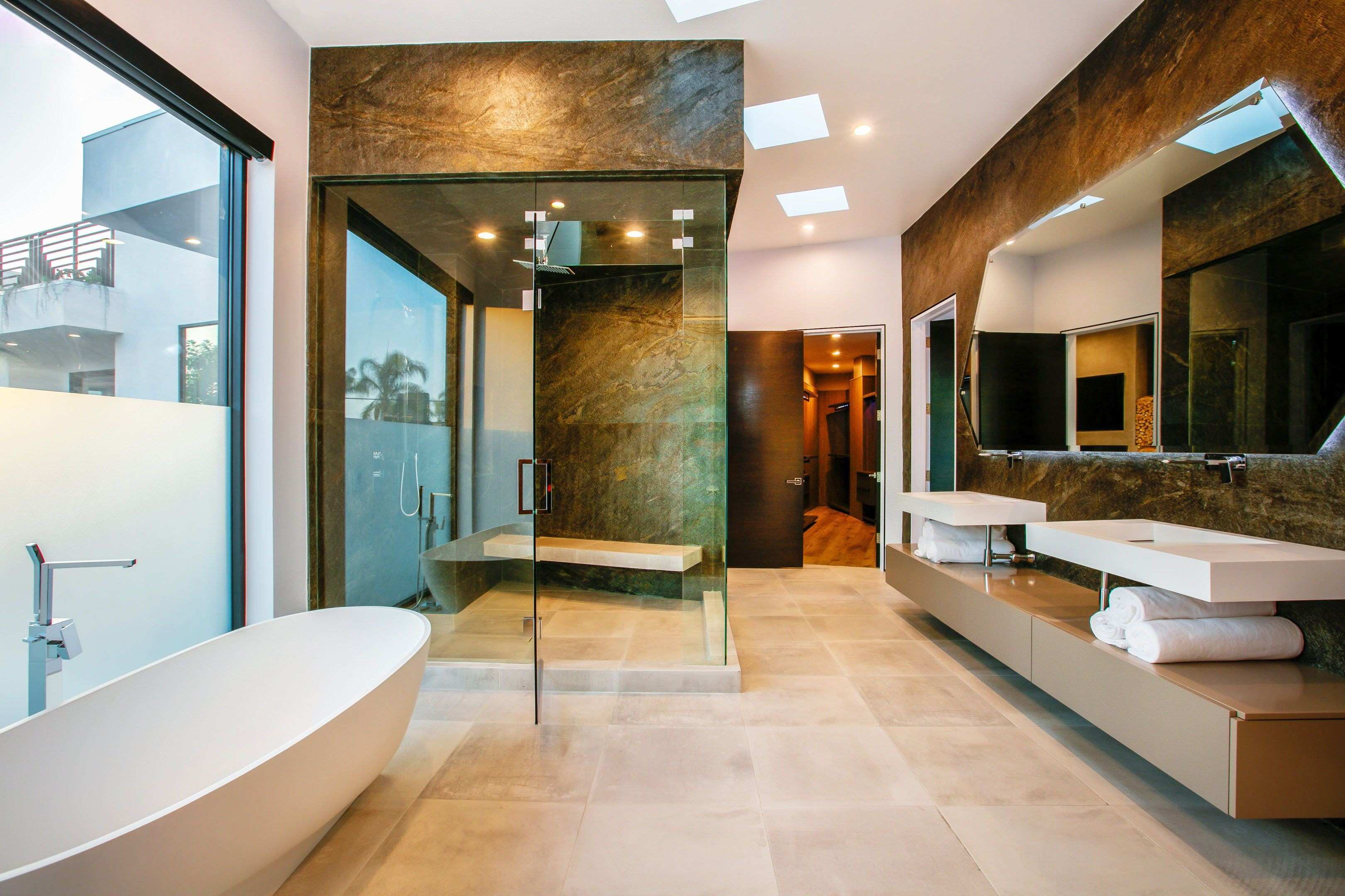 Custom designed master bathroom featuring walk in shower and bench