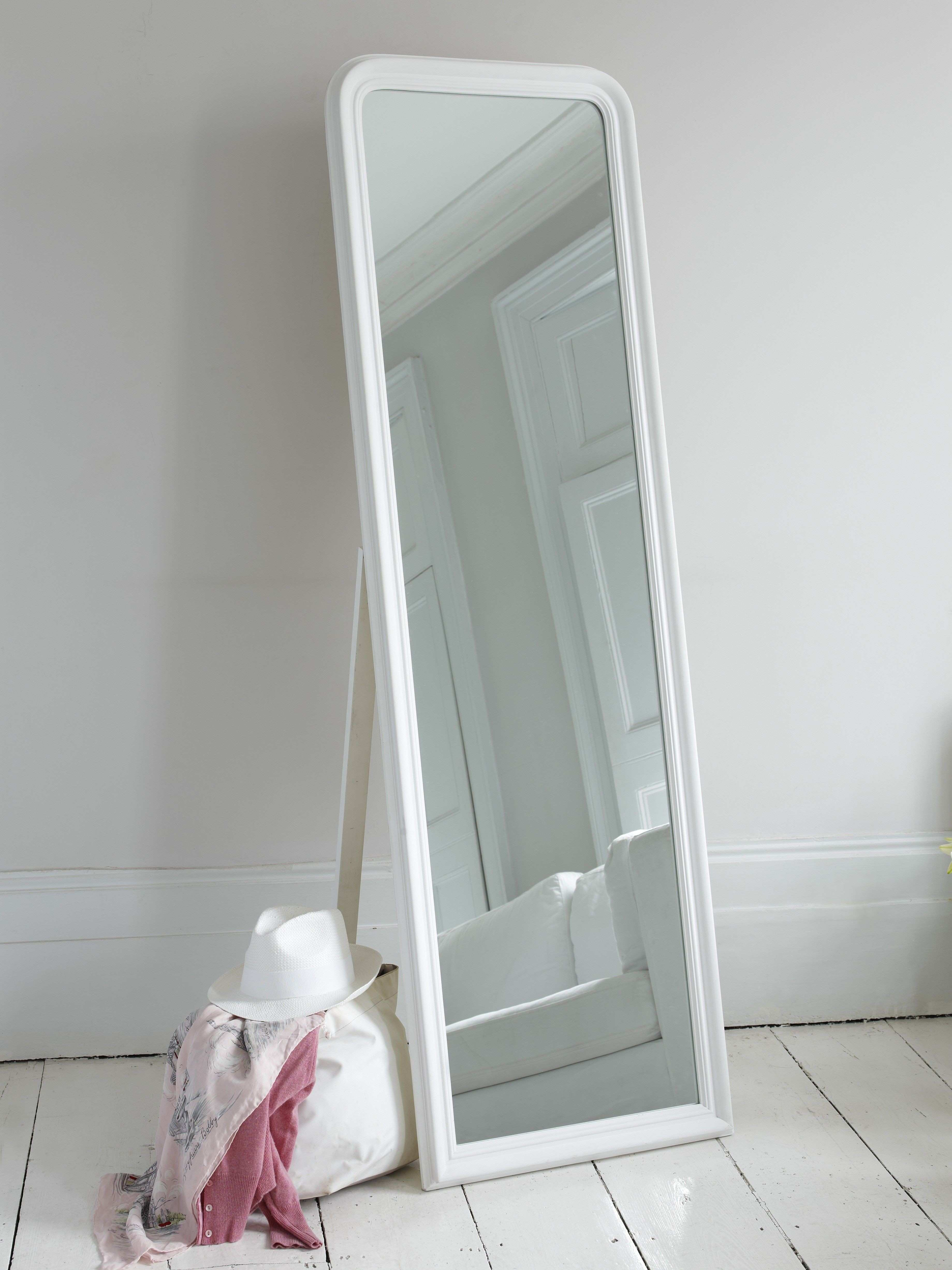 An easy and sleek full length mirror in a matte white finish with