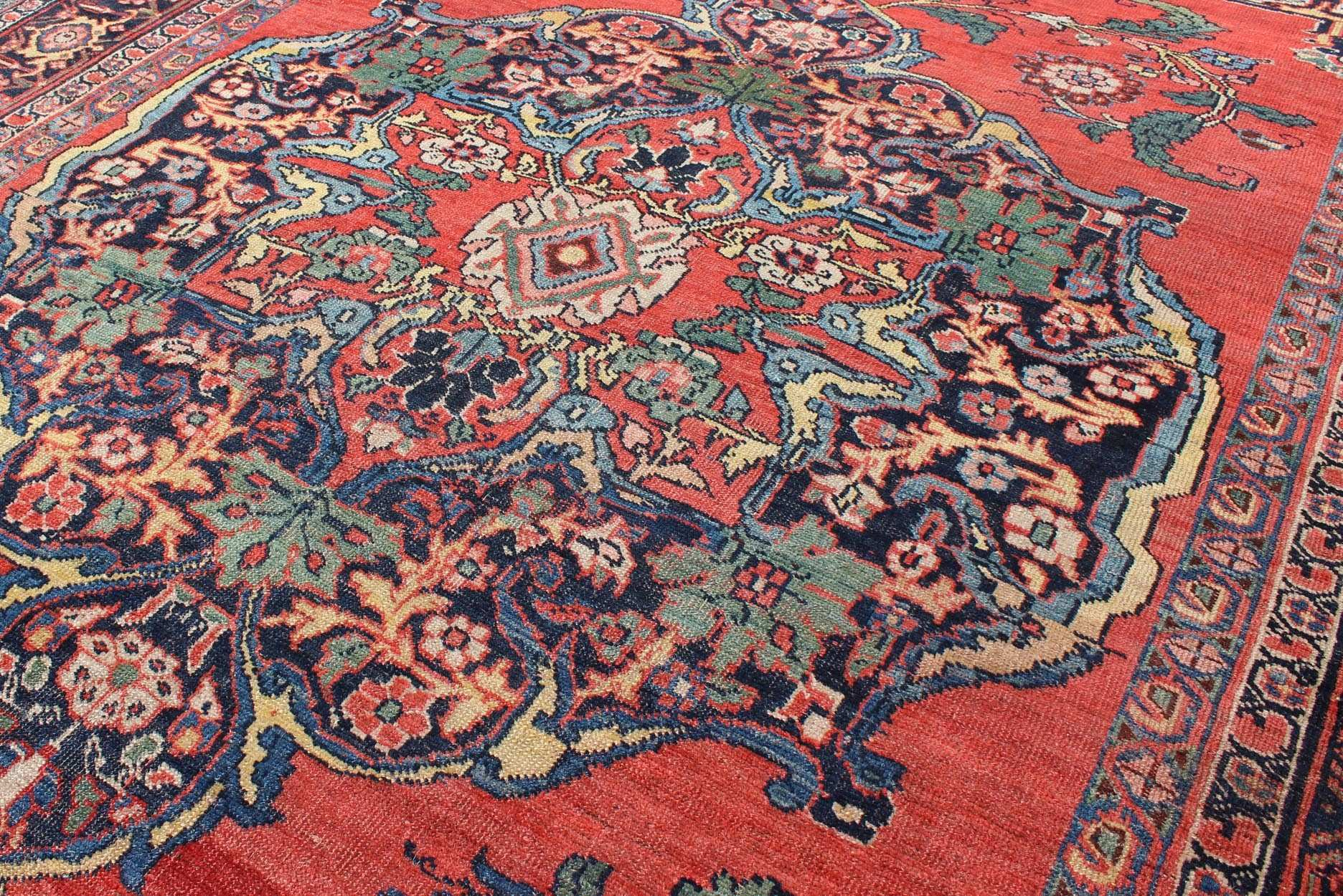 Red Background 1920s Antique Persian Bidjar Rug with Floral