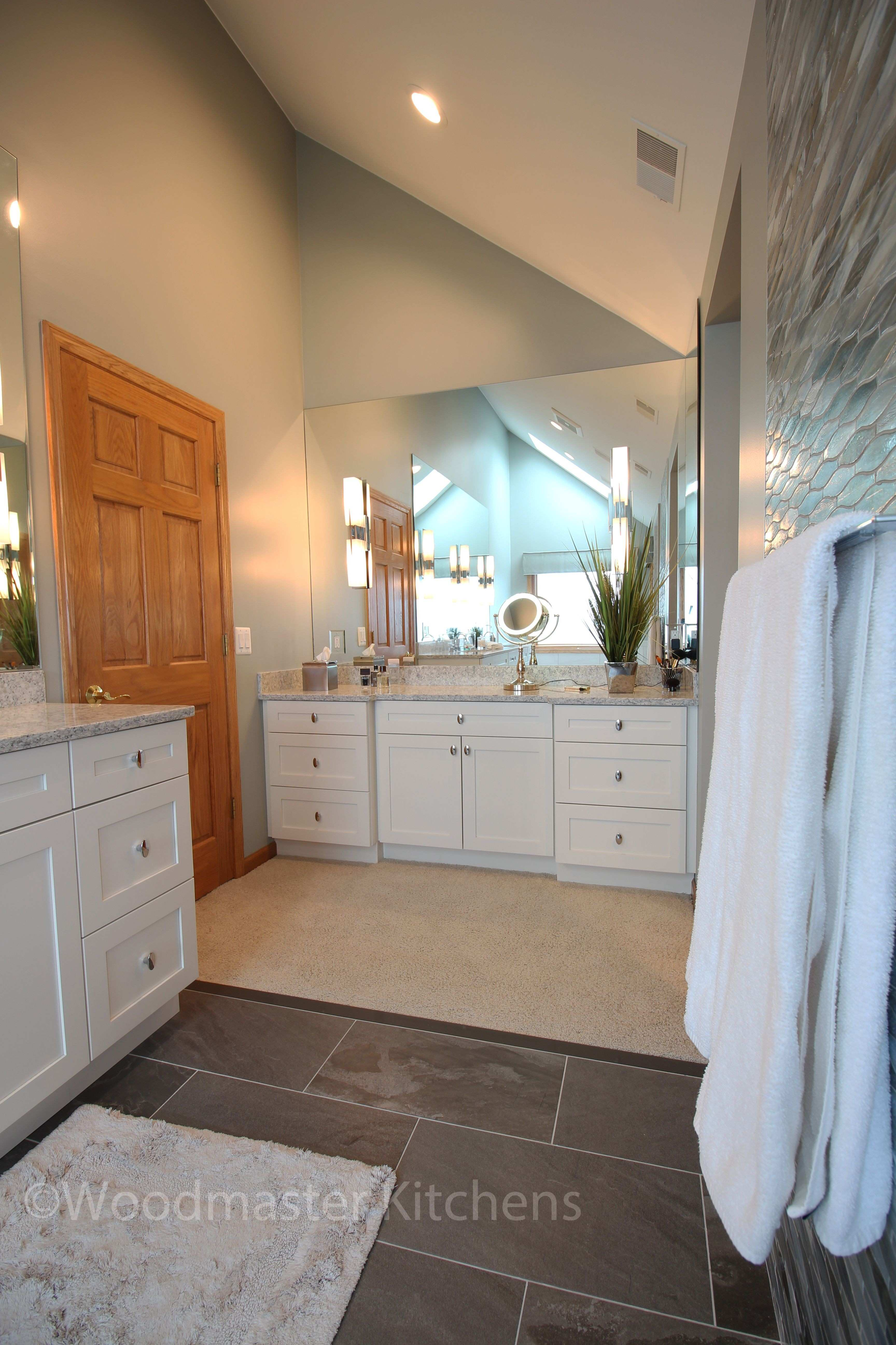 This contemporary bathroom design in Harrison Township maximizes the