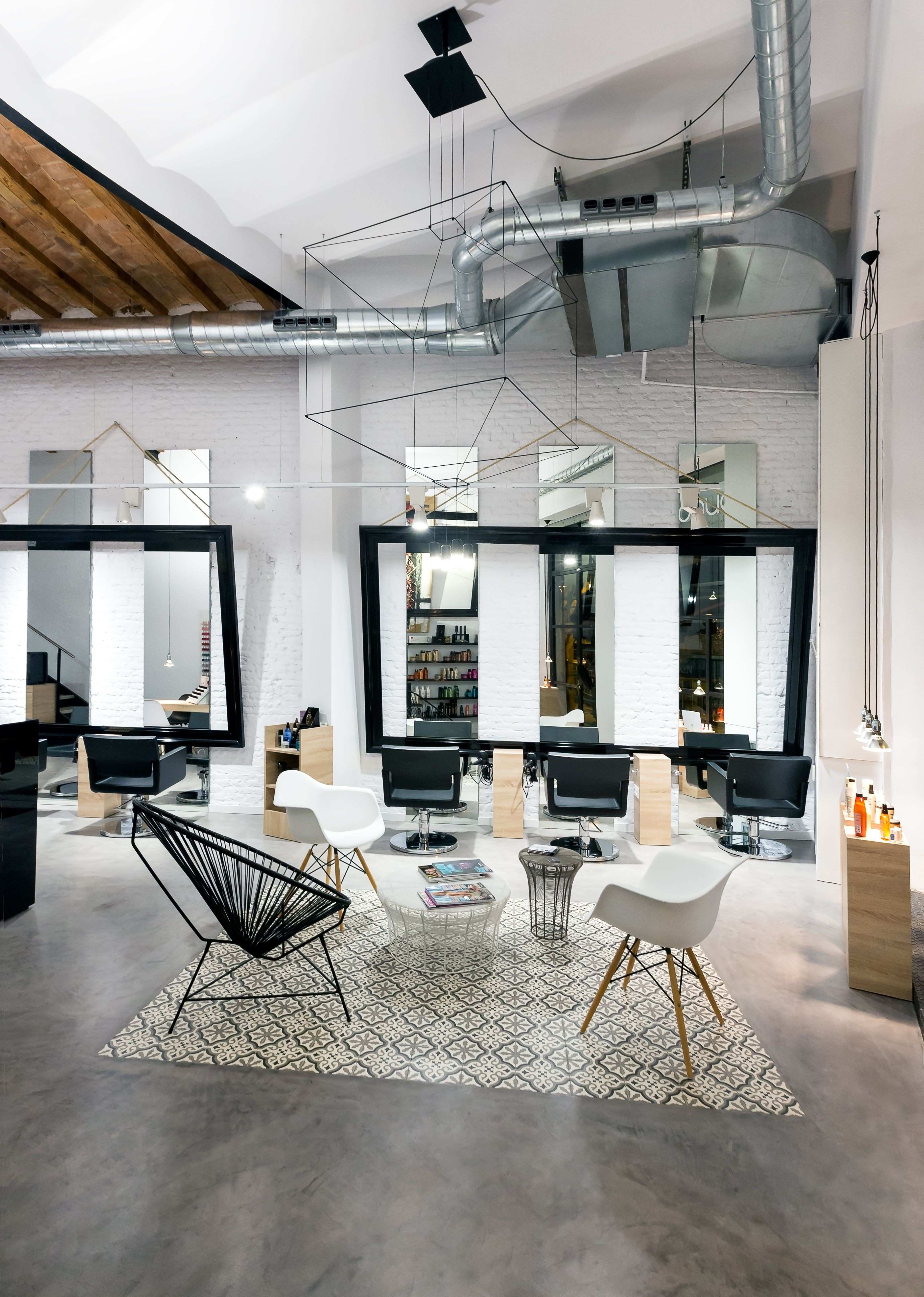 A volumetric WIREFLOW design lights up the lounge at Noguera Hair