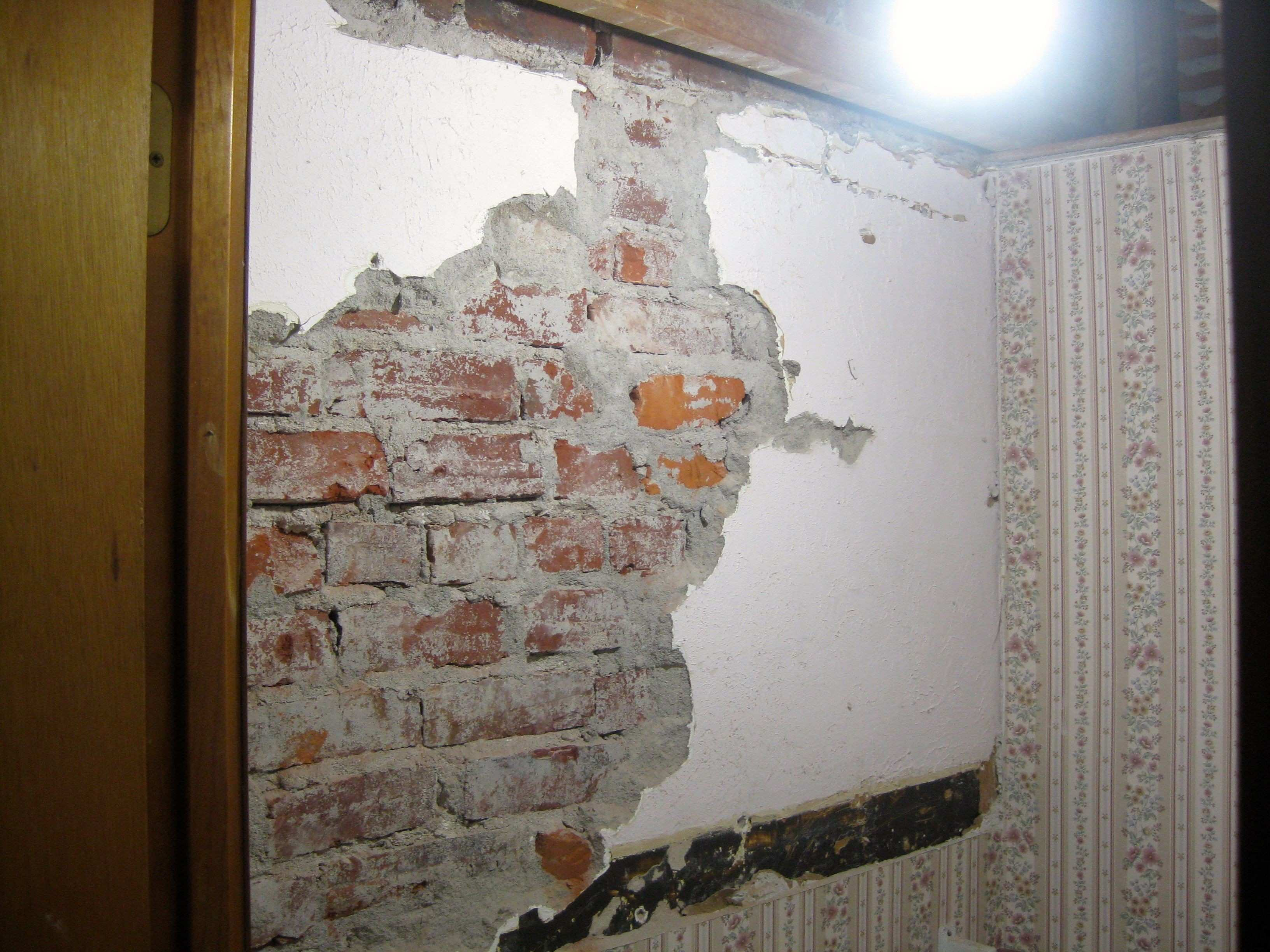 Chiseled off the plaster to expose the brick wall