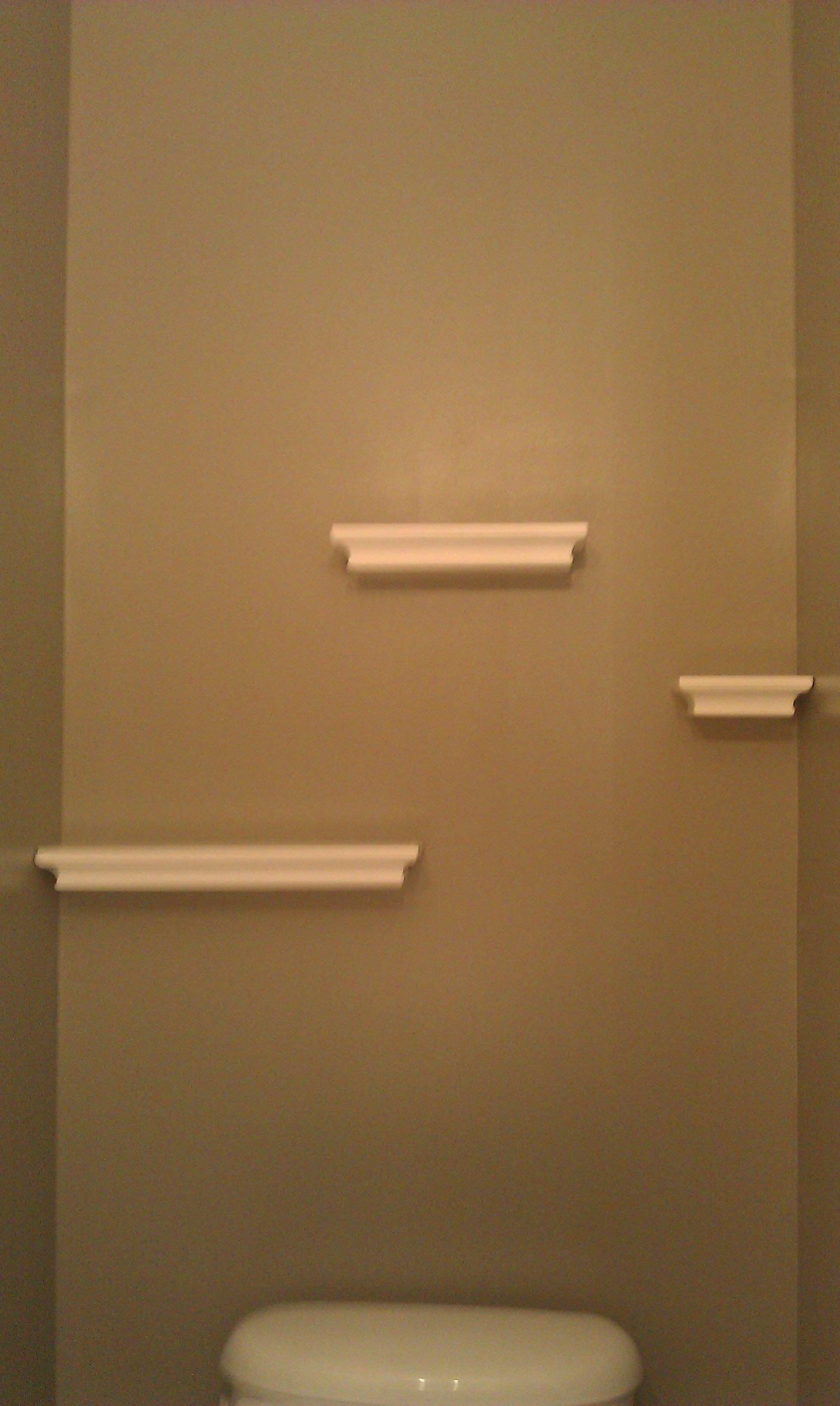 Floating shelves in the powder room hung with mand Strips by 3M