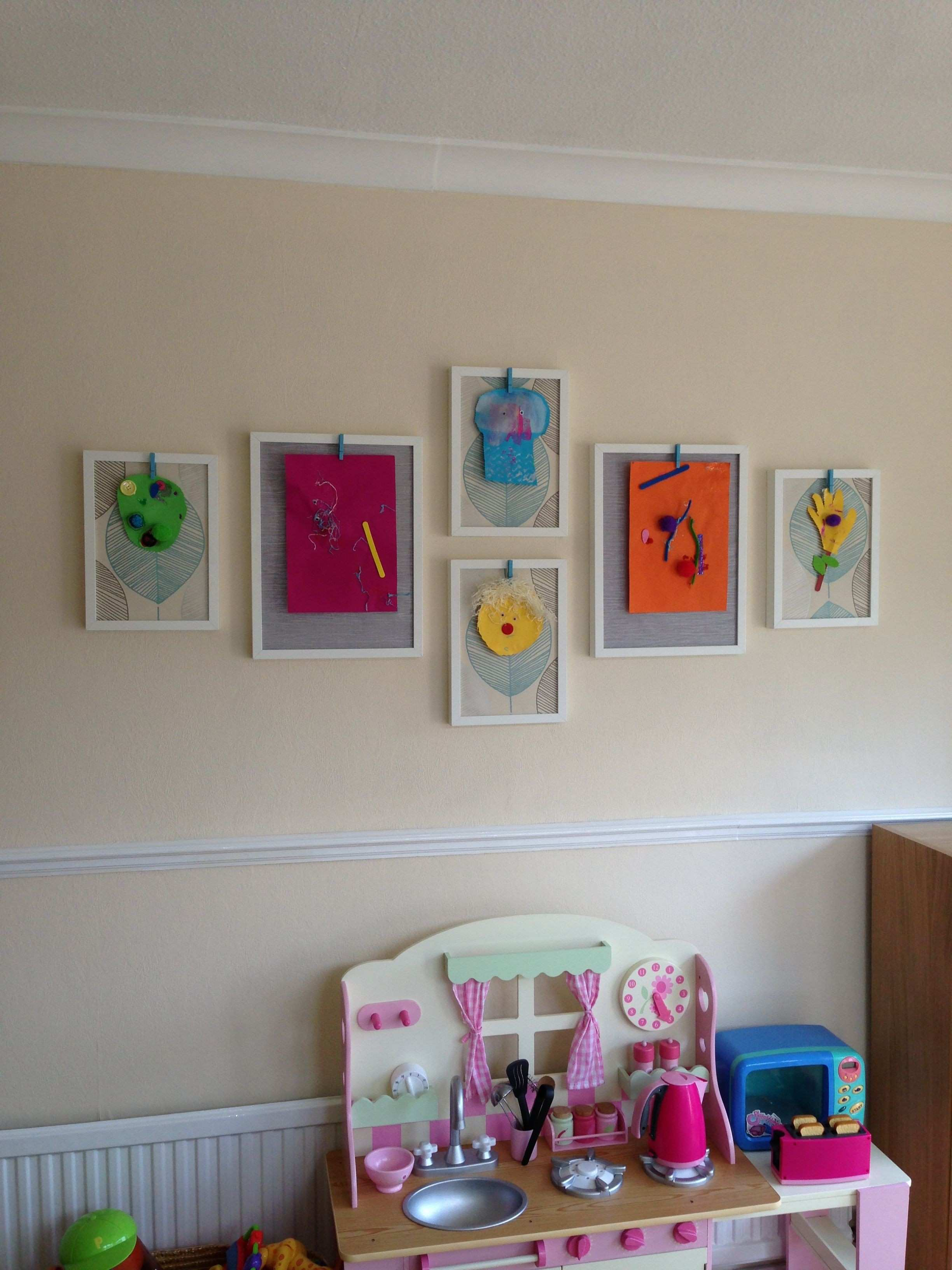Kids art wall display Made with ikea frames wallpaper samples and
