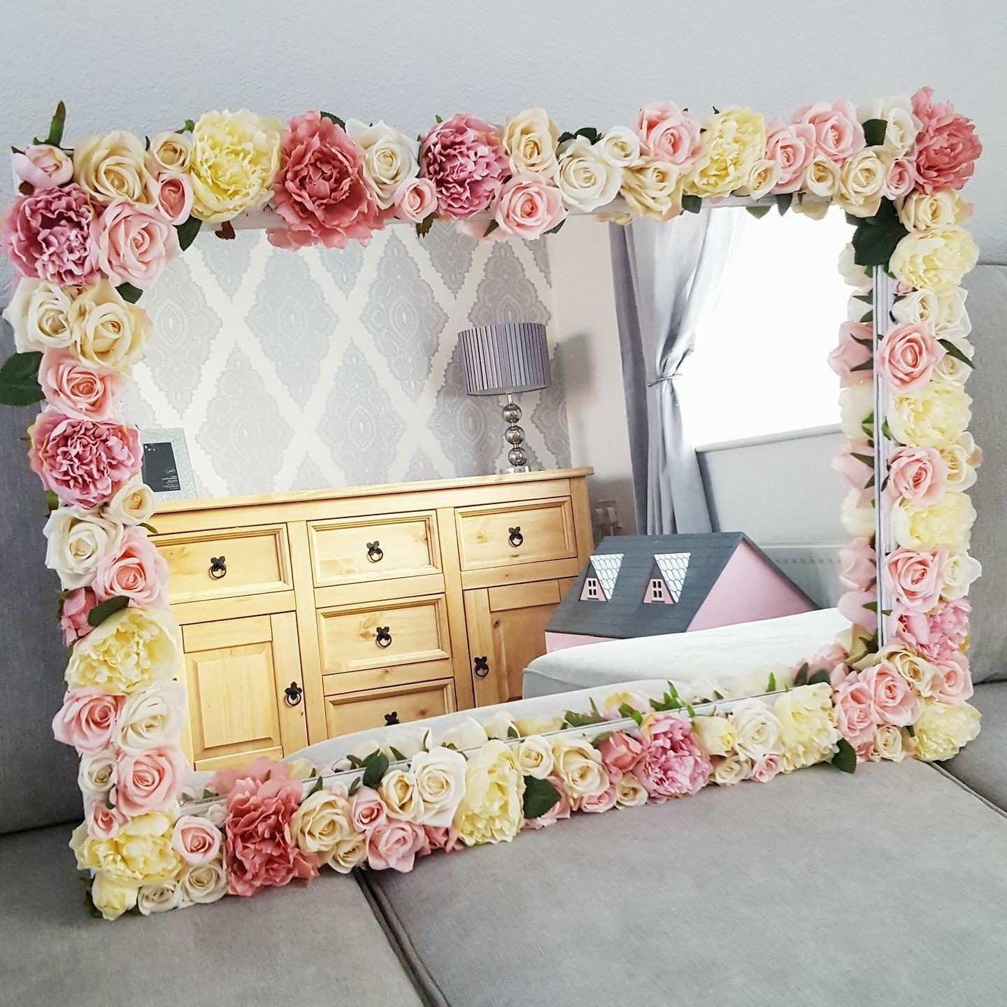 DIY Flower mirror Glue the artificial flowers on