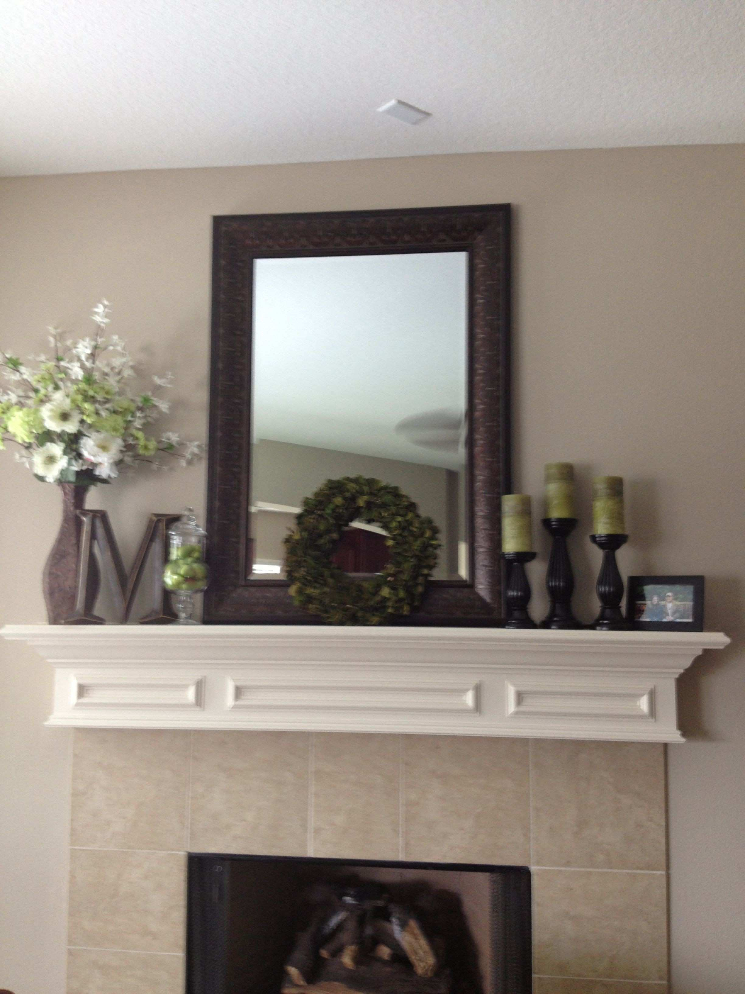 Mantle decor By me Mirror Kirklands Candles wreath Garden