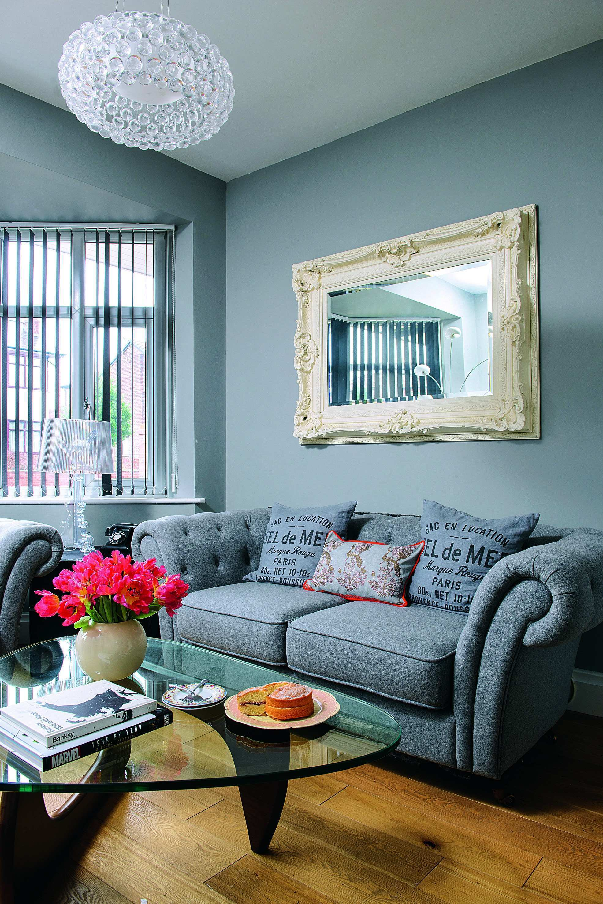 Hang a statement mirror above your sofa to make the space feel