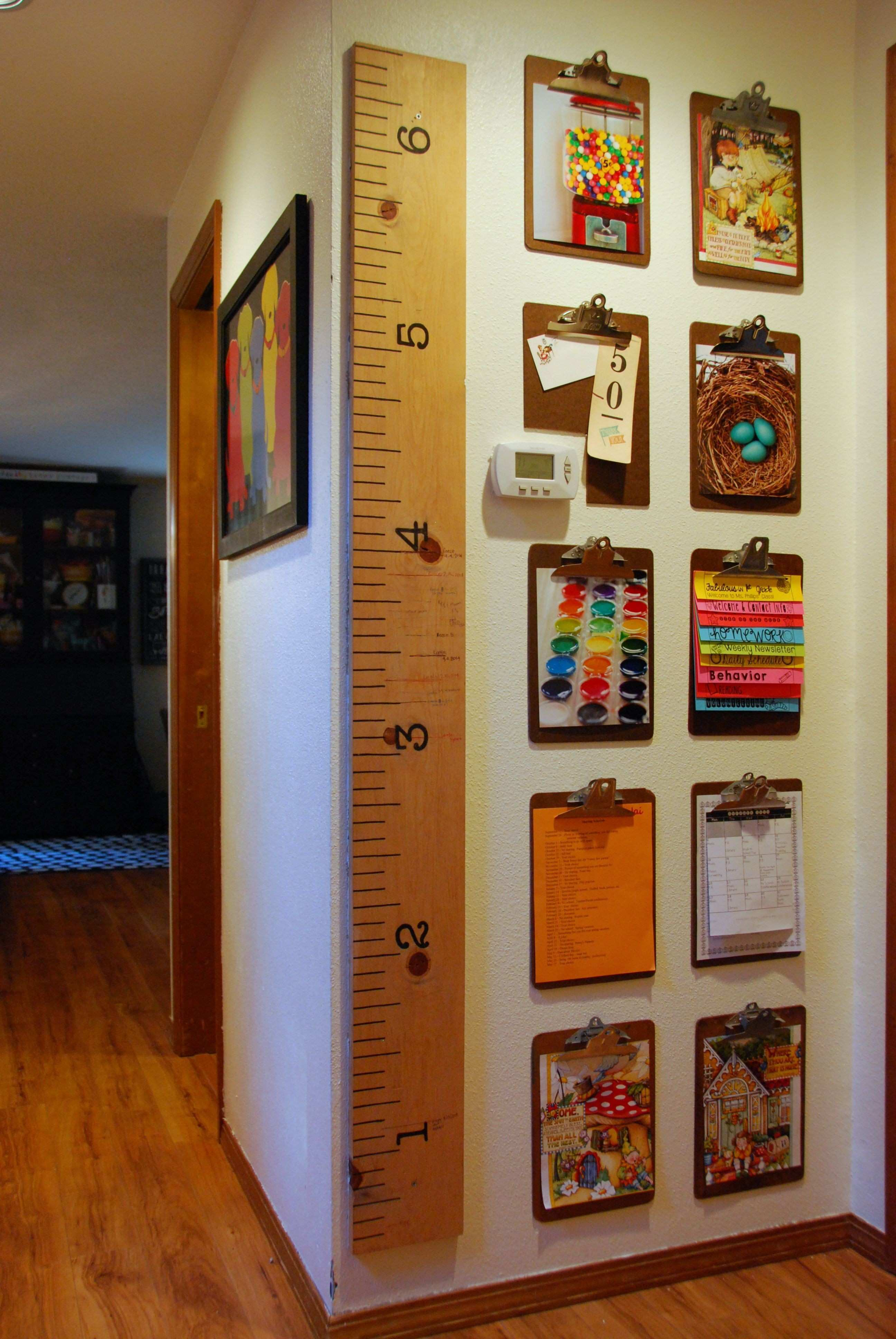 thrifted clipboards used to create a gallery wall for kids artwork
