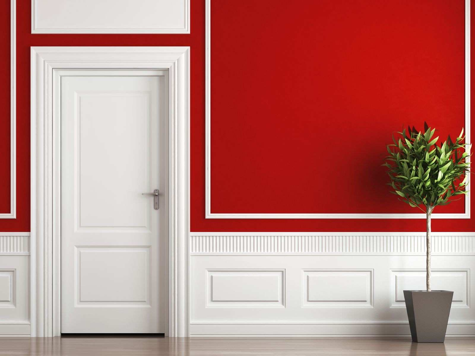 Red Walls & White Molding White picture frame molding gives this