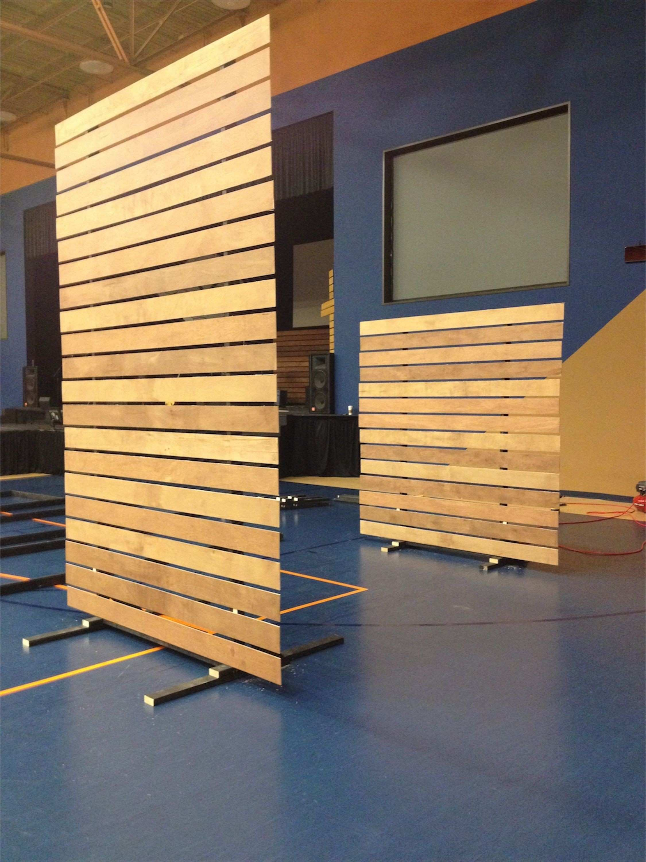 create a moveable partition wall on rollers for functional