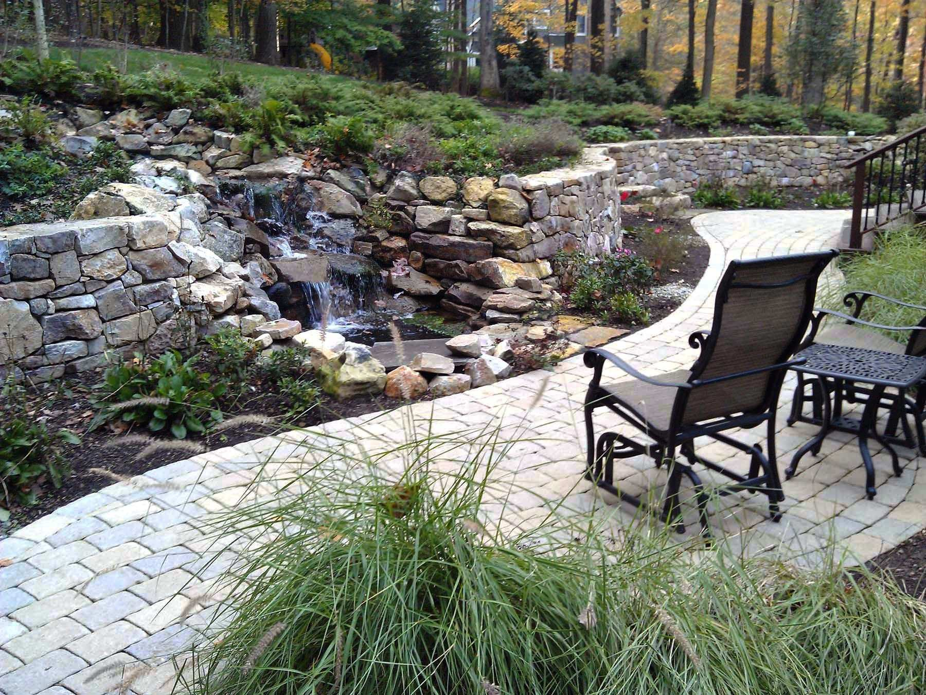 outdoor retreat with waterfall and natural stone walls
