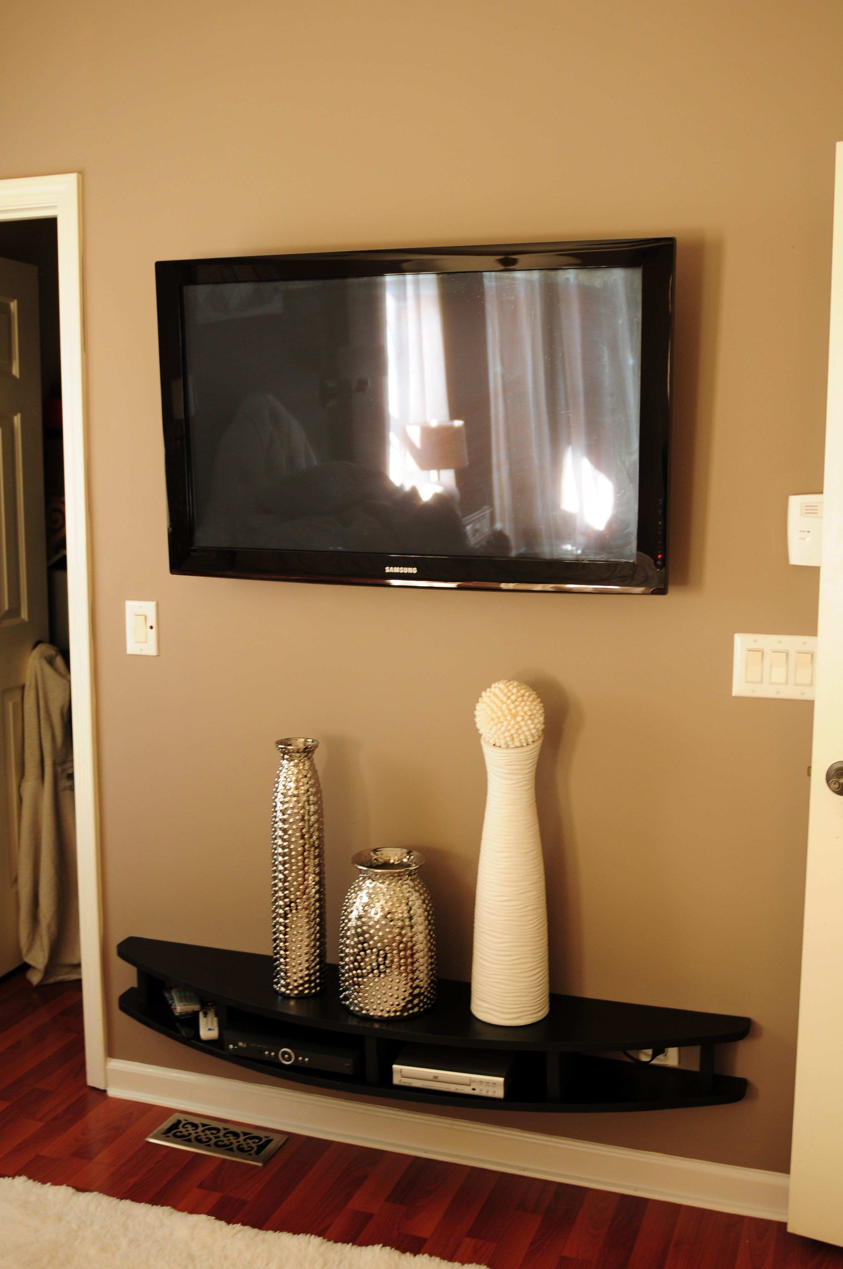 Hubby built modern shelves to wall mount under tv He is so smart