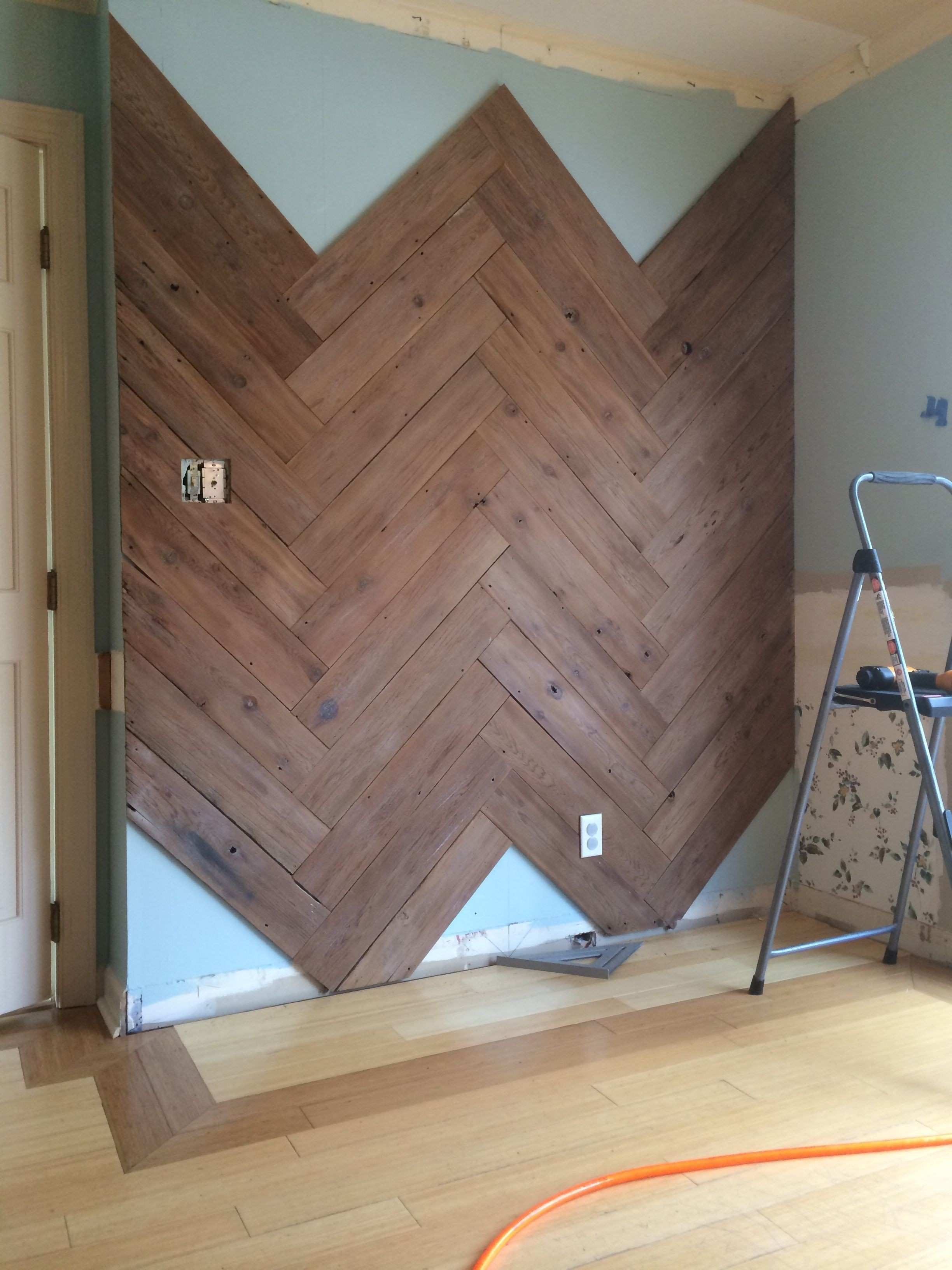 DIY Plank Wall in Herringbone Made From Old Fence