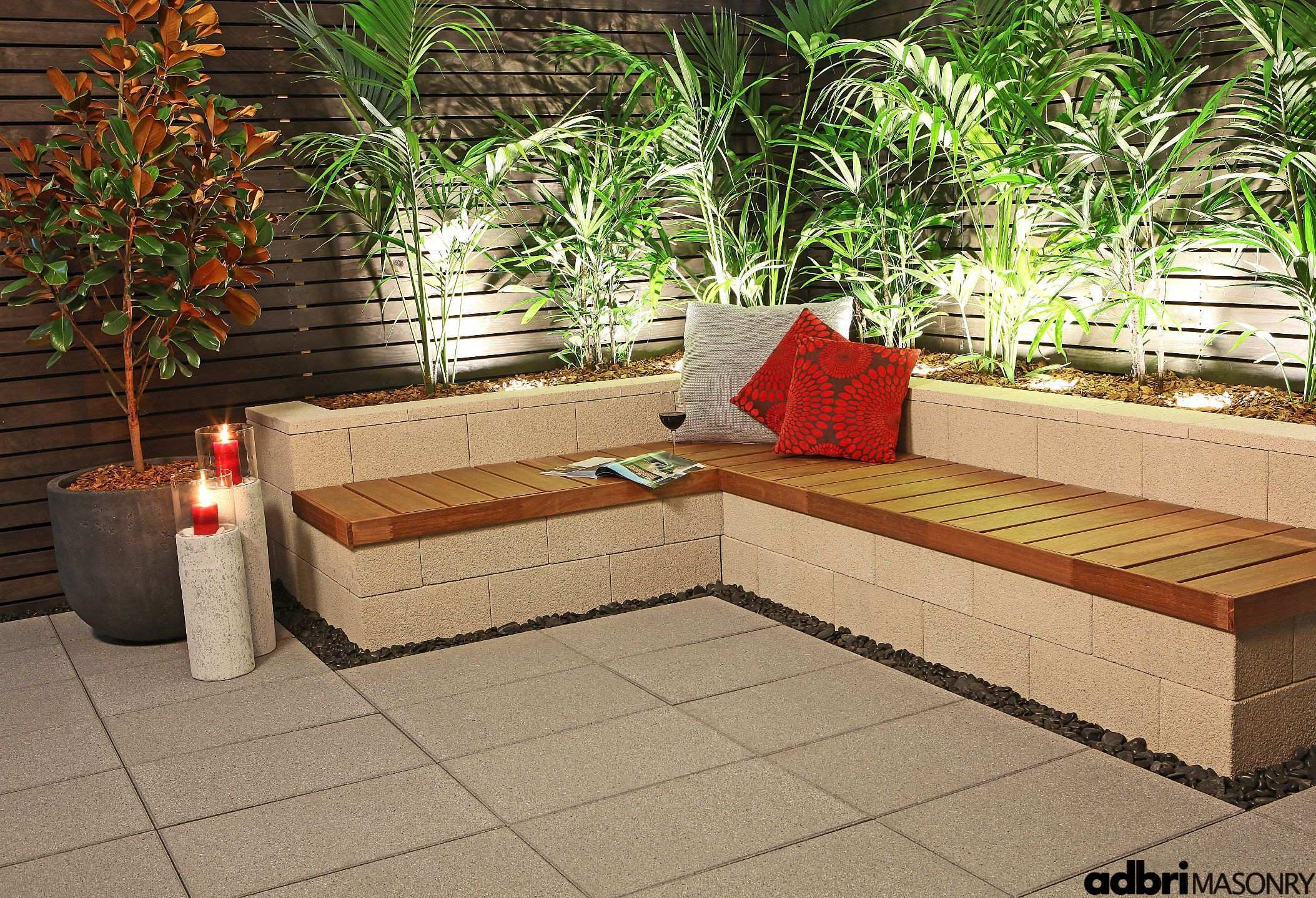 Use retaining wall blocks to create some built in furniture