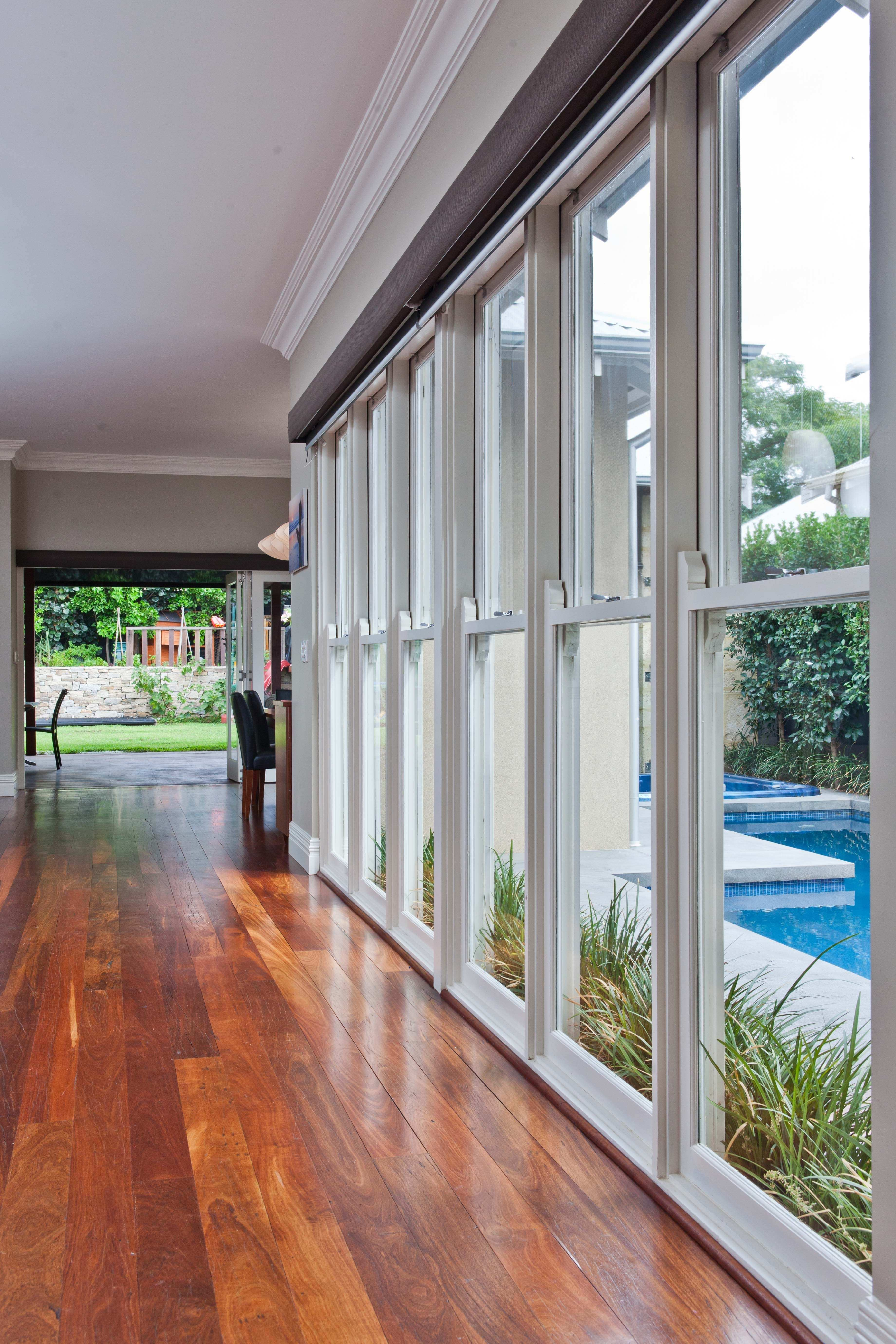 Double hung windows as pool fencing to the home