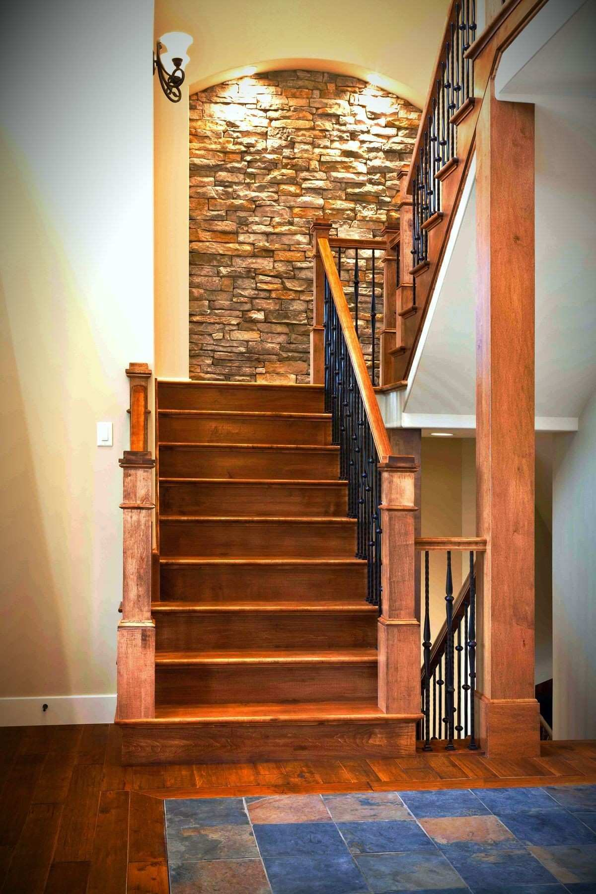 View of the stairs from the foyer A blend of textures stone wood