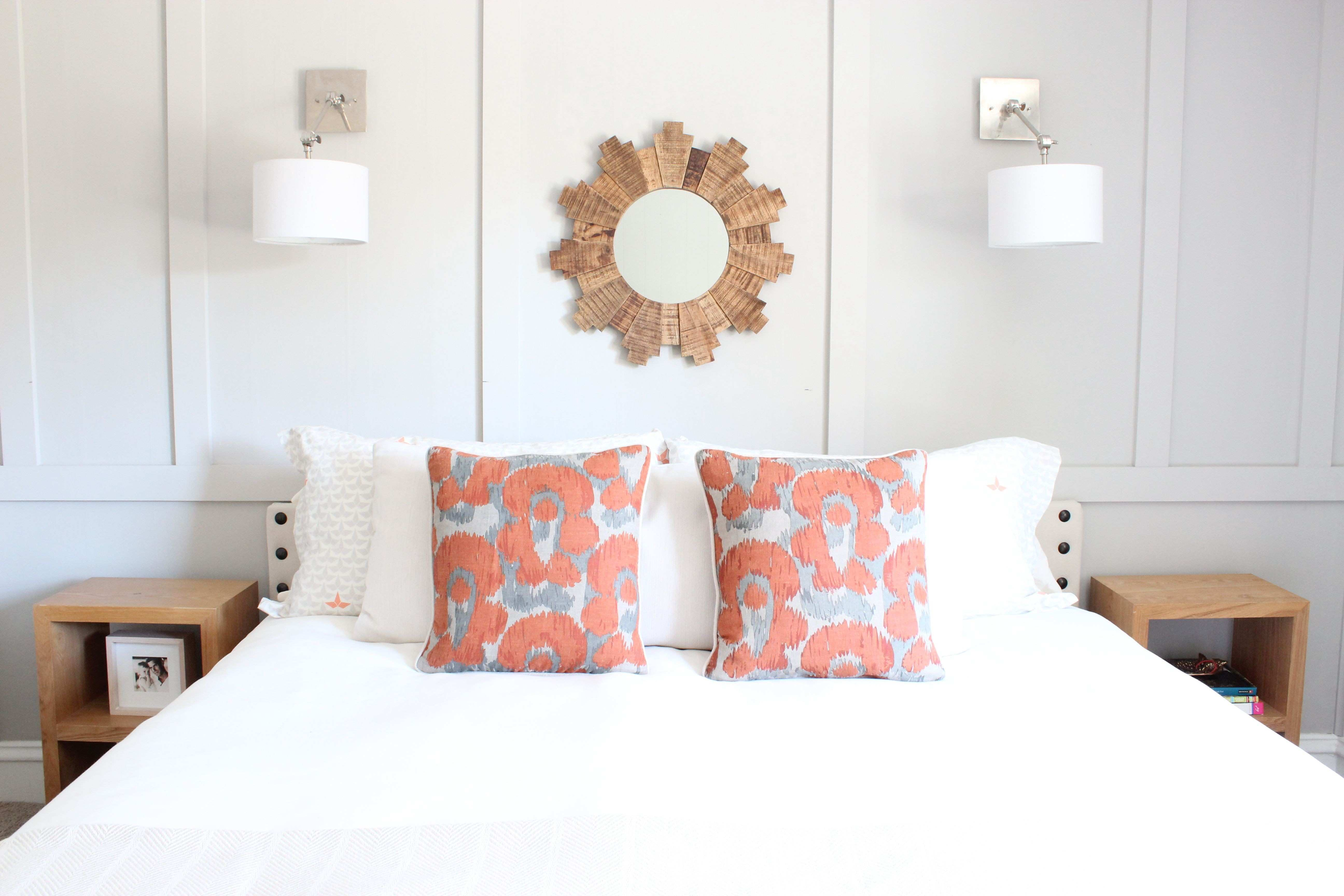 Board and Batten accent wall sunburst mirror swing arm sconces