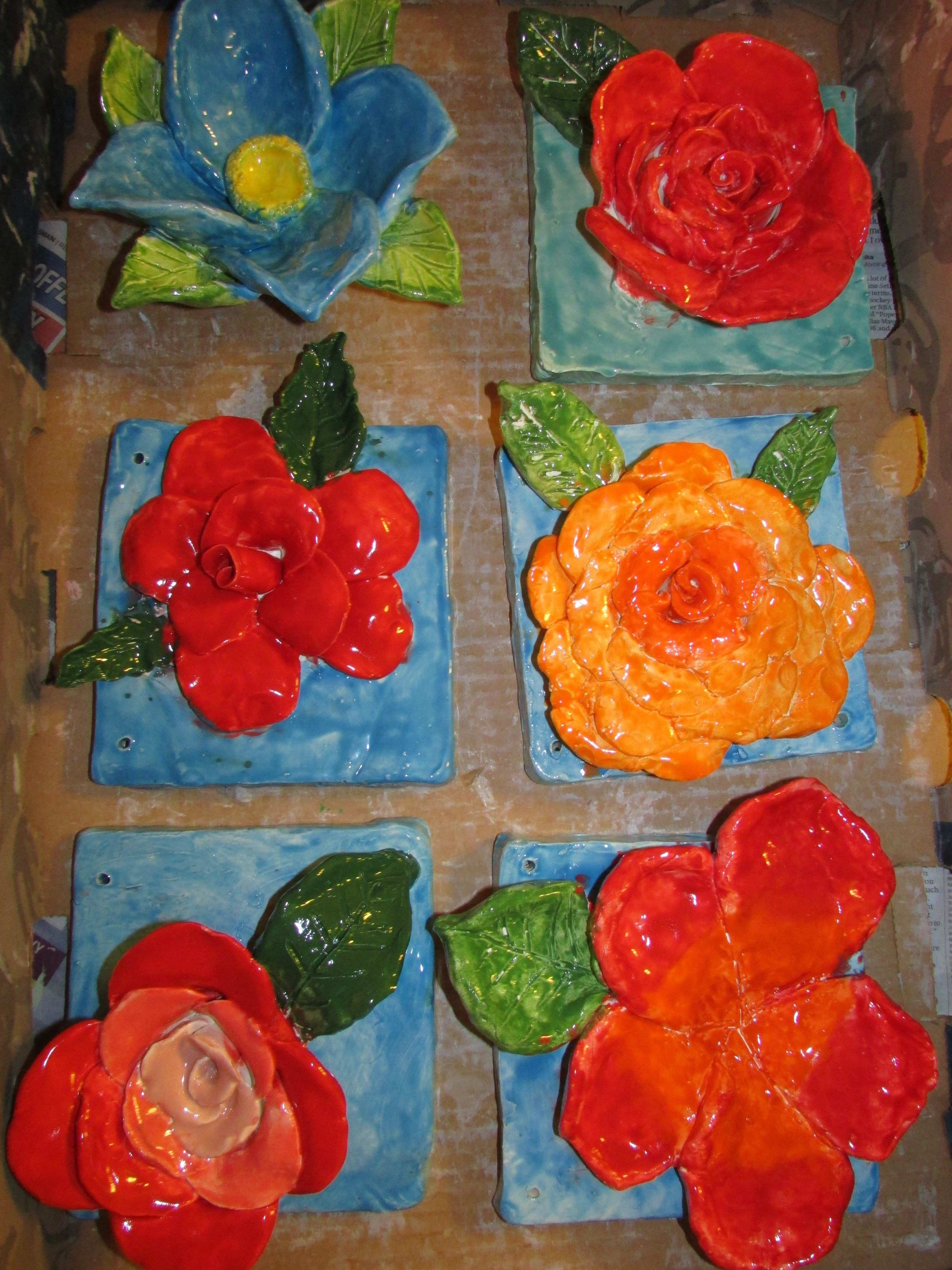 "ceramic flower sculptures by 1st through 4th graders approx 7"" X 7"