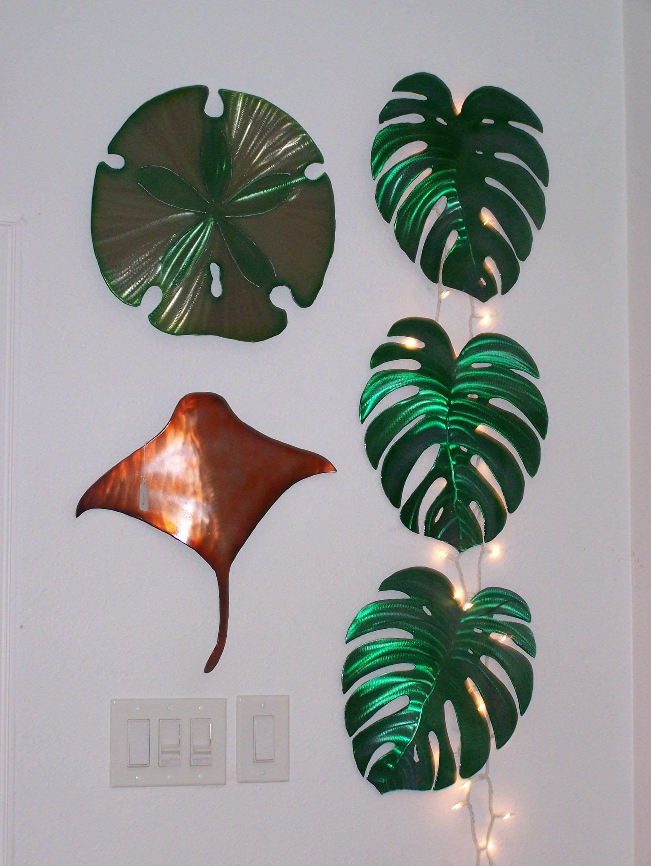Metal wall art Al moved here from Hawaii and makes sand dollars