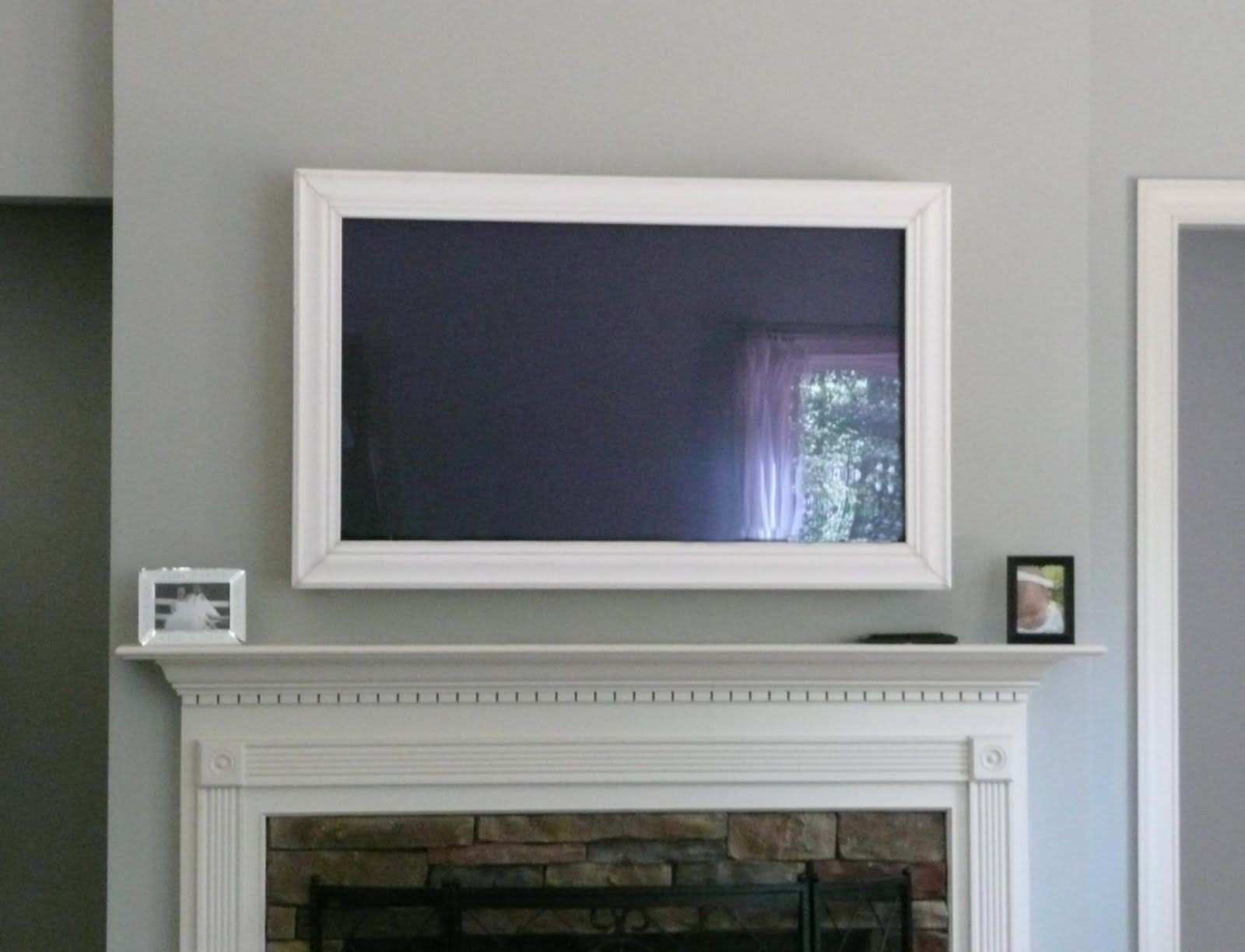 Image result for framed wall mounted flat screens that can be angled