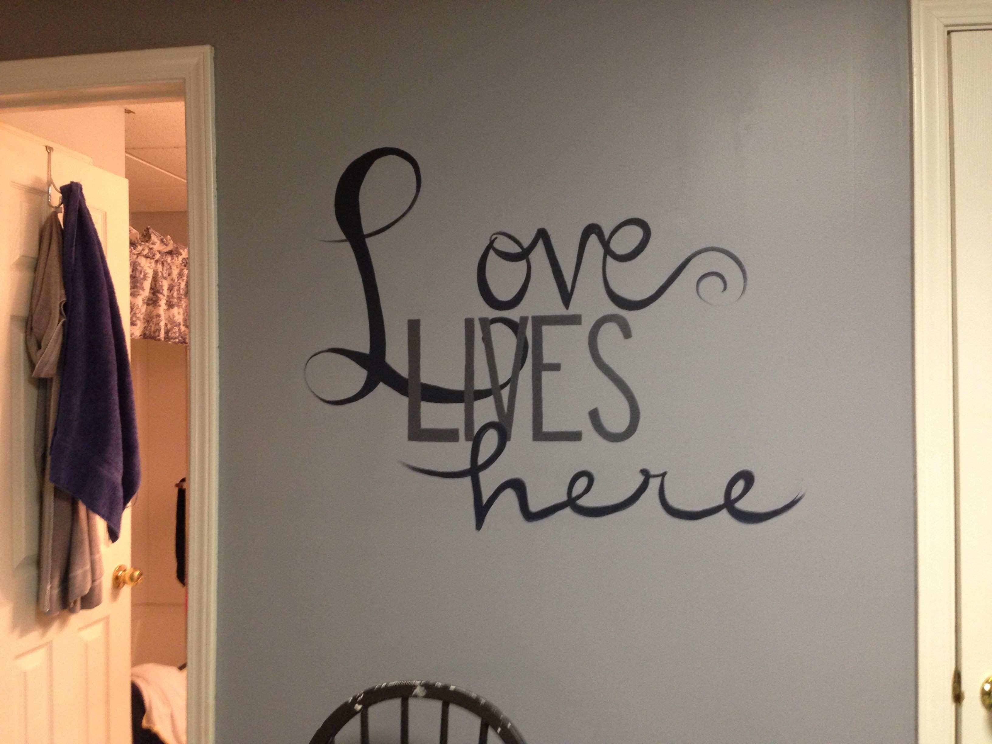 "Freehand mural lettering ""Love Lives Here"""