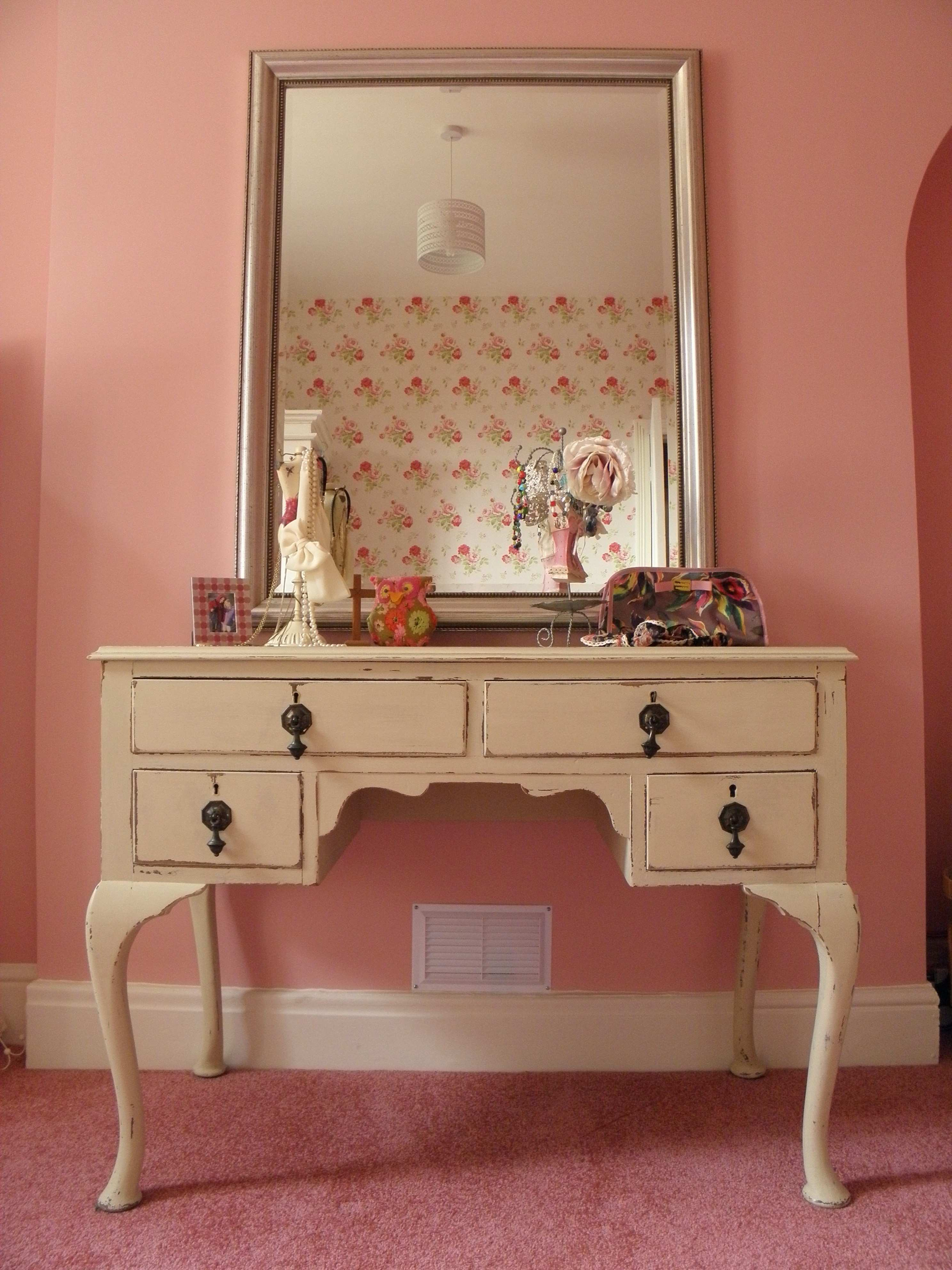 beige wooden Dressing Table with legs and drawers on pink rug added